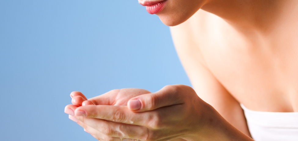 how to cleanse your skin woman washing face hands water