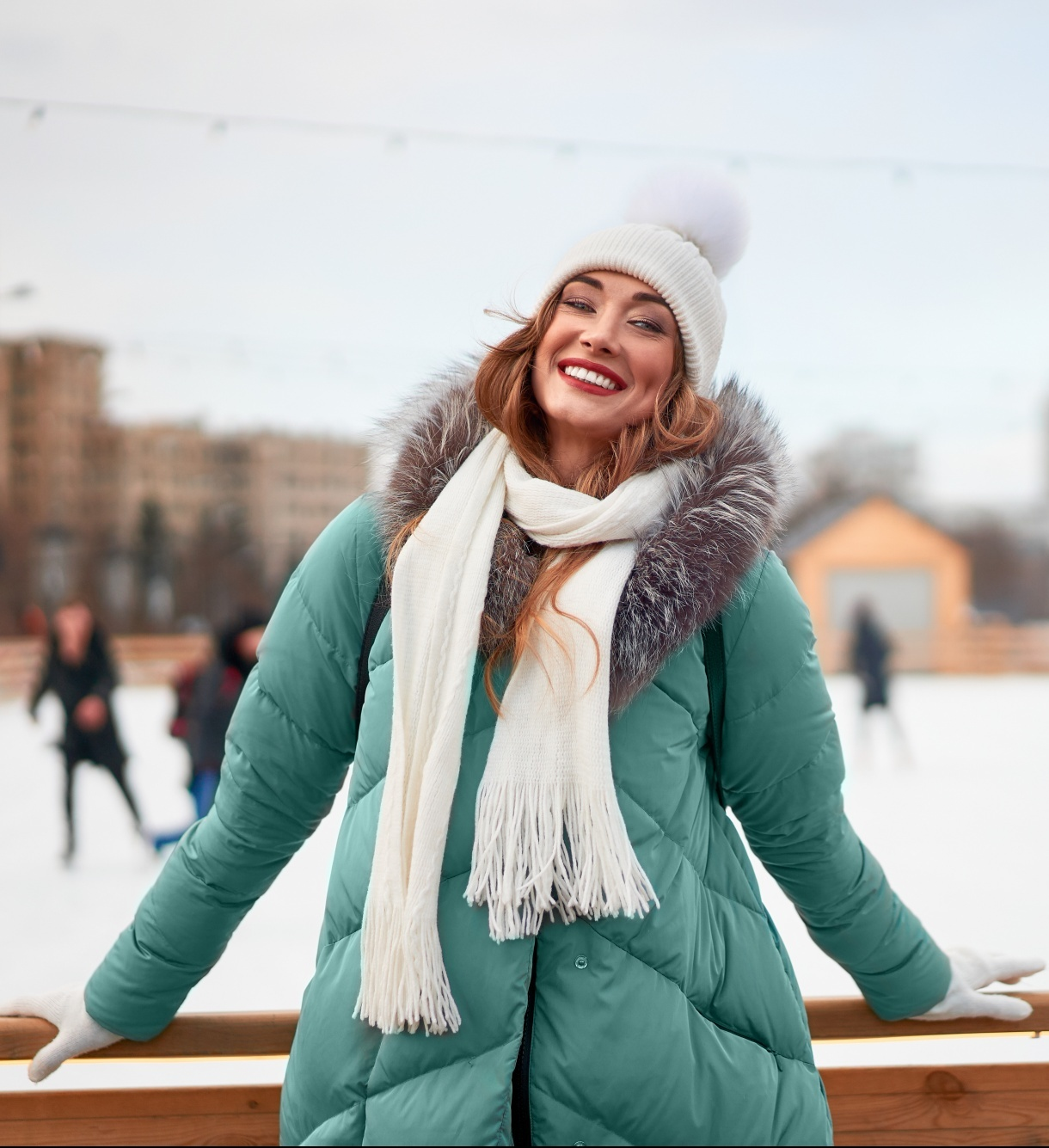 benefits of being outside during winter, middle aged woman at ice rink in teal puffer jacket and white hat and scarf