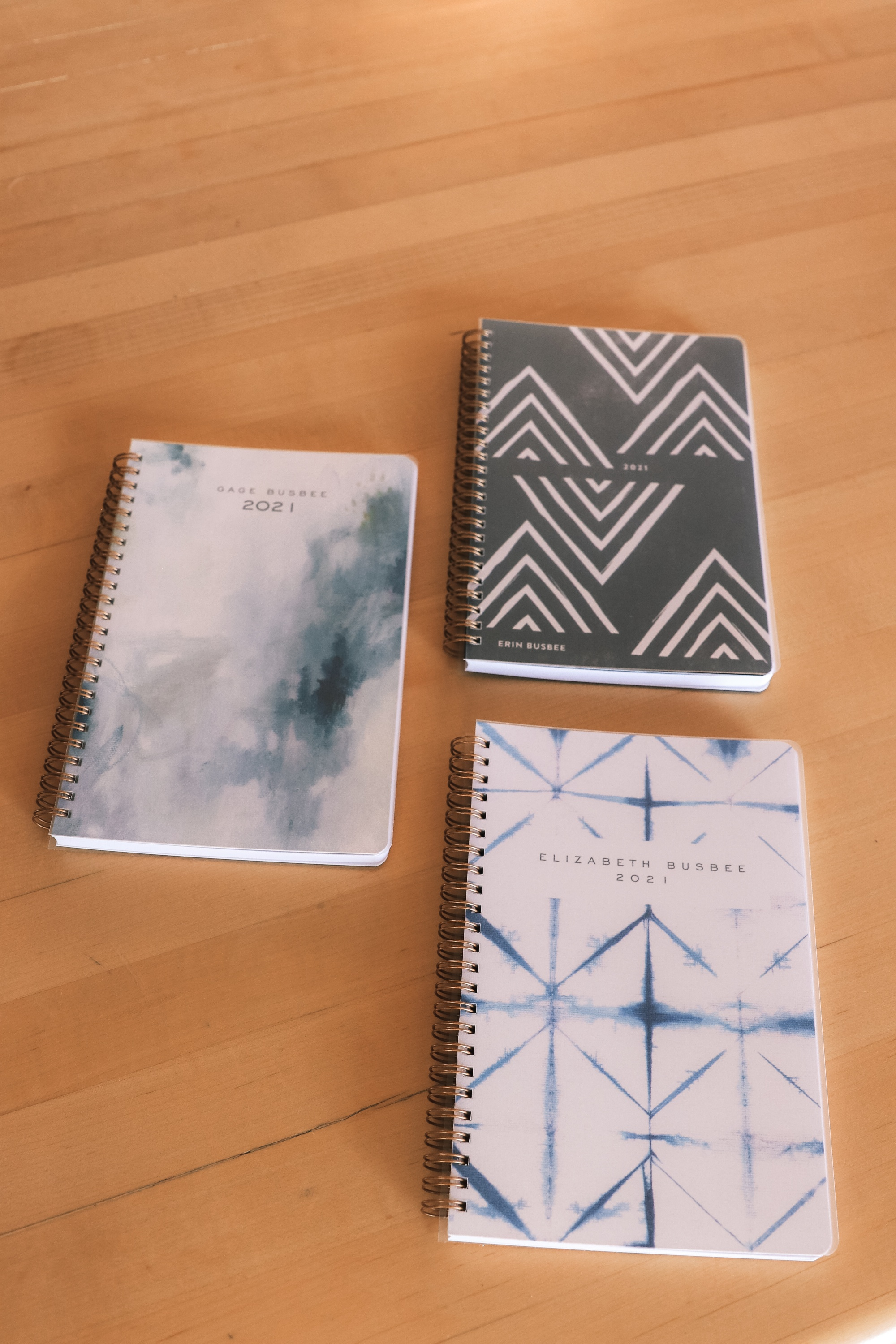 Personalized Gifts, Erin Busbee of Busbee Style sharing three customized planners for her son, daughter, and herself in a blue in Telluride, Colorado