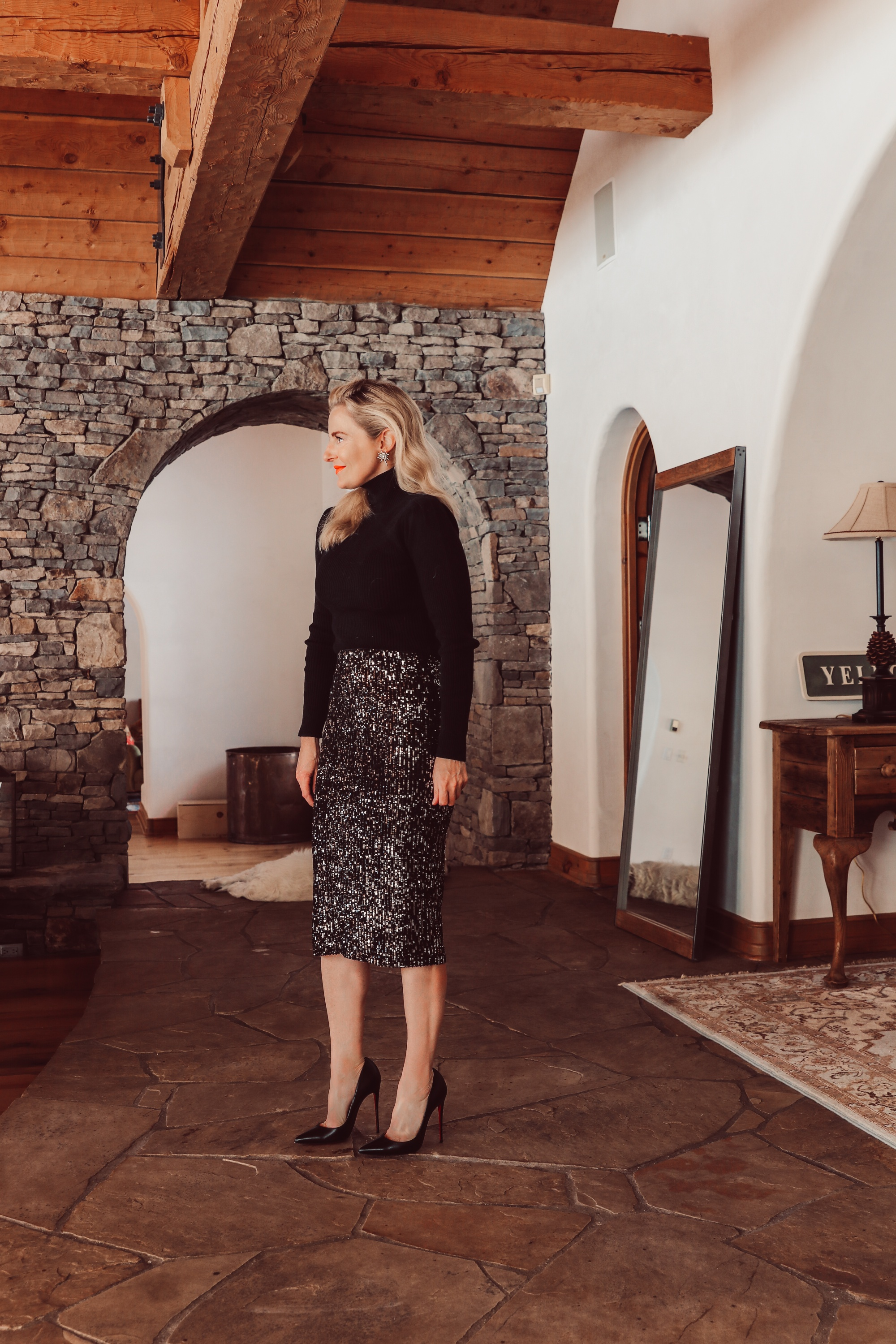 Simple holiday outfit idea featuring sequin midi skirt and black puff shoulder ribbed turtleneck from Walmart on fashion over 40 blogger Erin Busbee