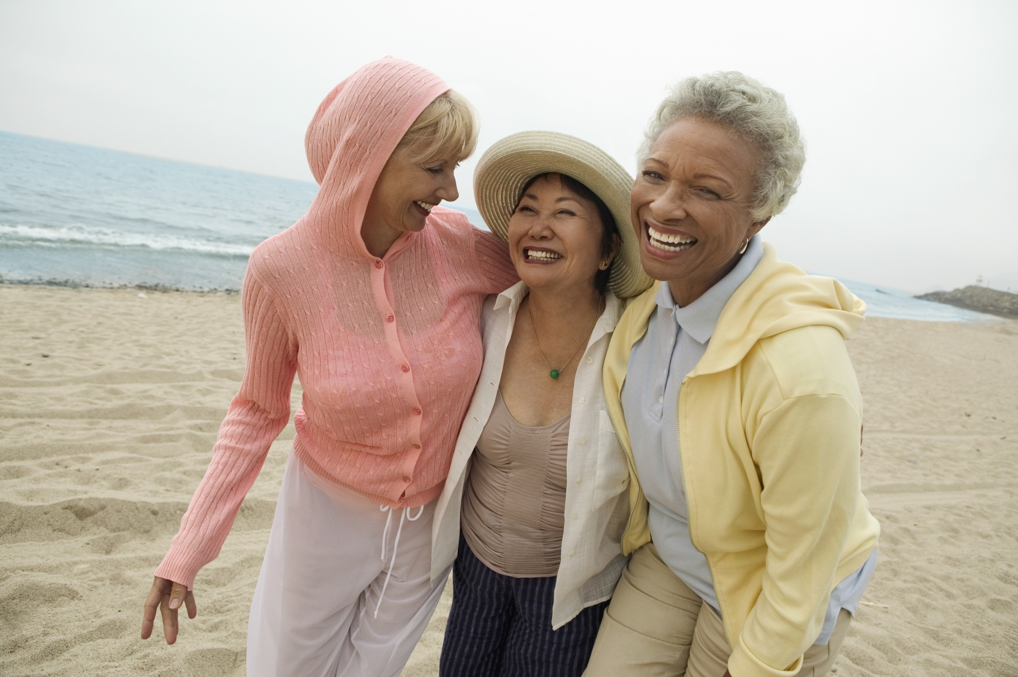 positive things about menopause, Portrait of happy middle aged female friends enjoying vacation at beach