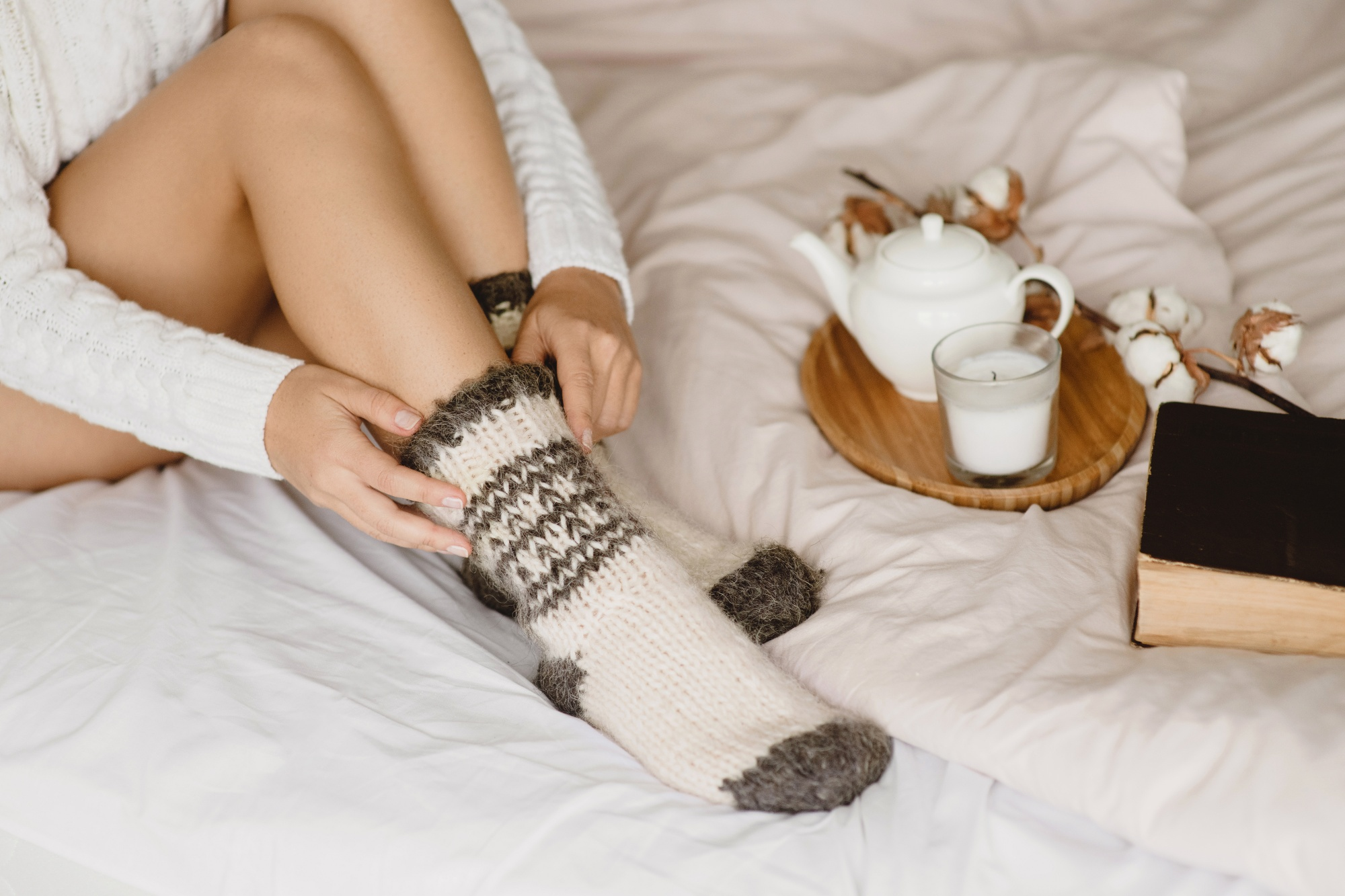 finding hygge at home, sharing how to stay-cozy and content-at-home-with-a-book-tea-and-warm-socks