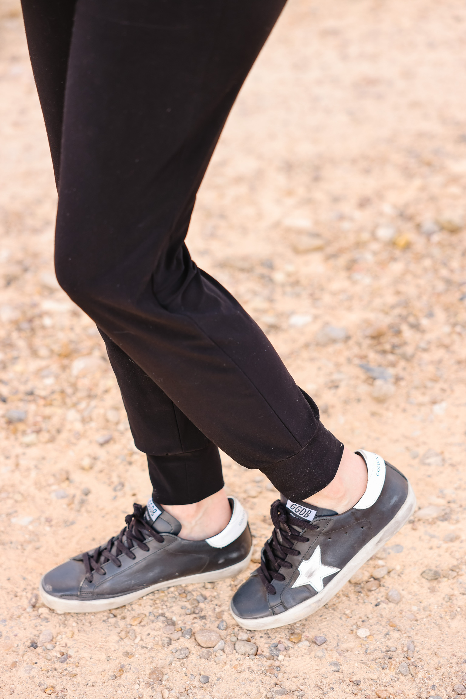 Elevated Basics, Erin Busbee of Busbee wearing black golden goose sneakers with black joggers by Norma Kamali in south texas