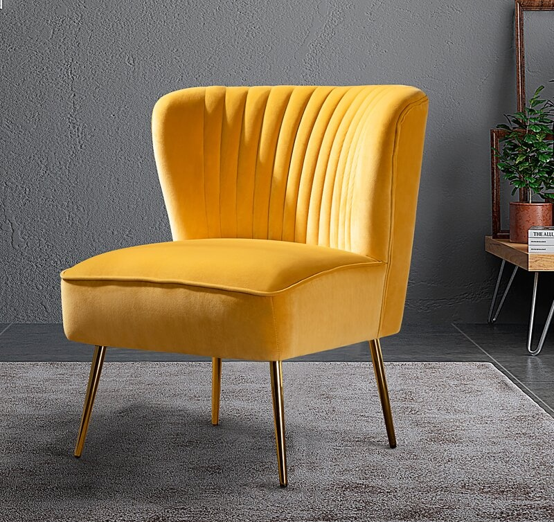 Revealing Pantone's 2021 colors of the year illuminating yellow and ultimate grey featuring a bright yellow chair with gray painted walls