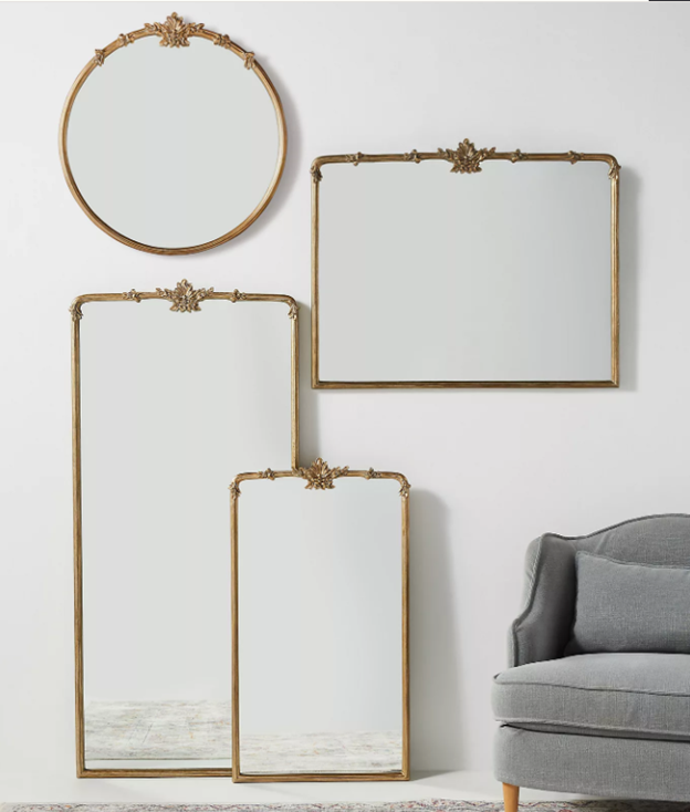 Revealing Pantone's 2021 colors of the year illuminating yellow and ultimate grey showcasing a variety of gold mirrors next to a grey chair