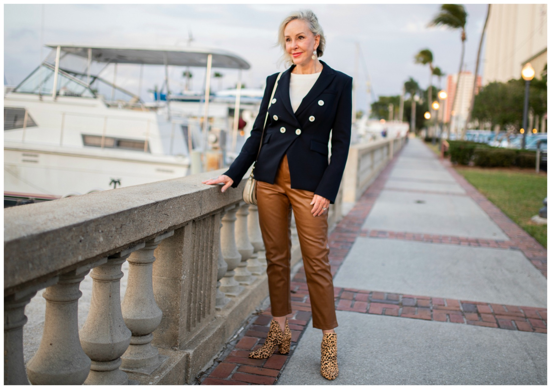 Styling Blazers Over 40, Sheree from SheShe Show wearing a double breasted blazer with whtie top, cognac faux leather pants, and leopard booties