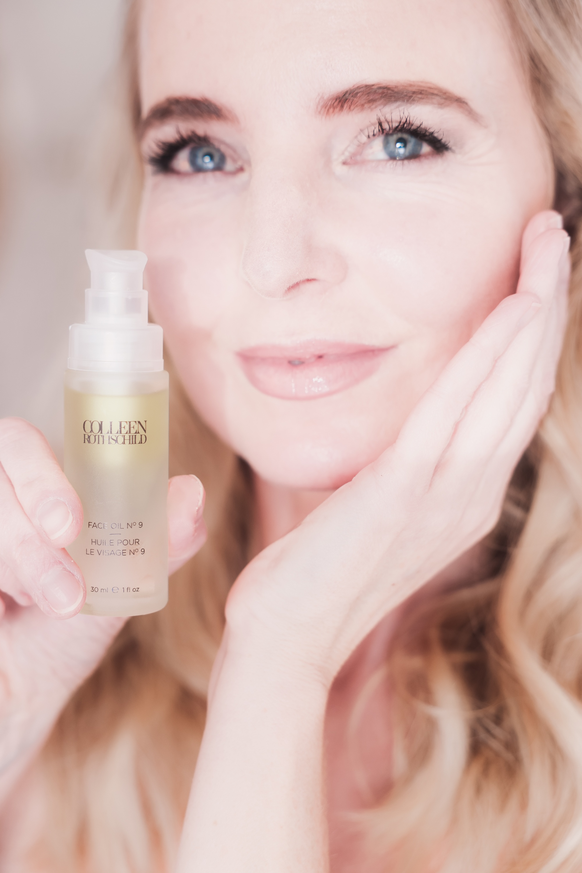 Best Skincare Over 40, Erin Busbee of Busbee using the Colleen Rothschild Face Oil No. 9 in her bathroom in Telluride, Colorado