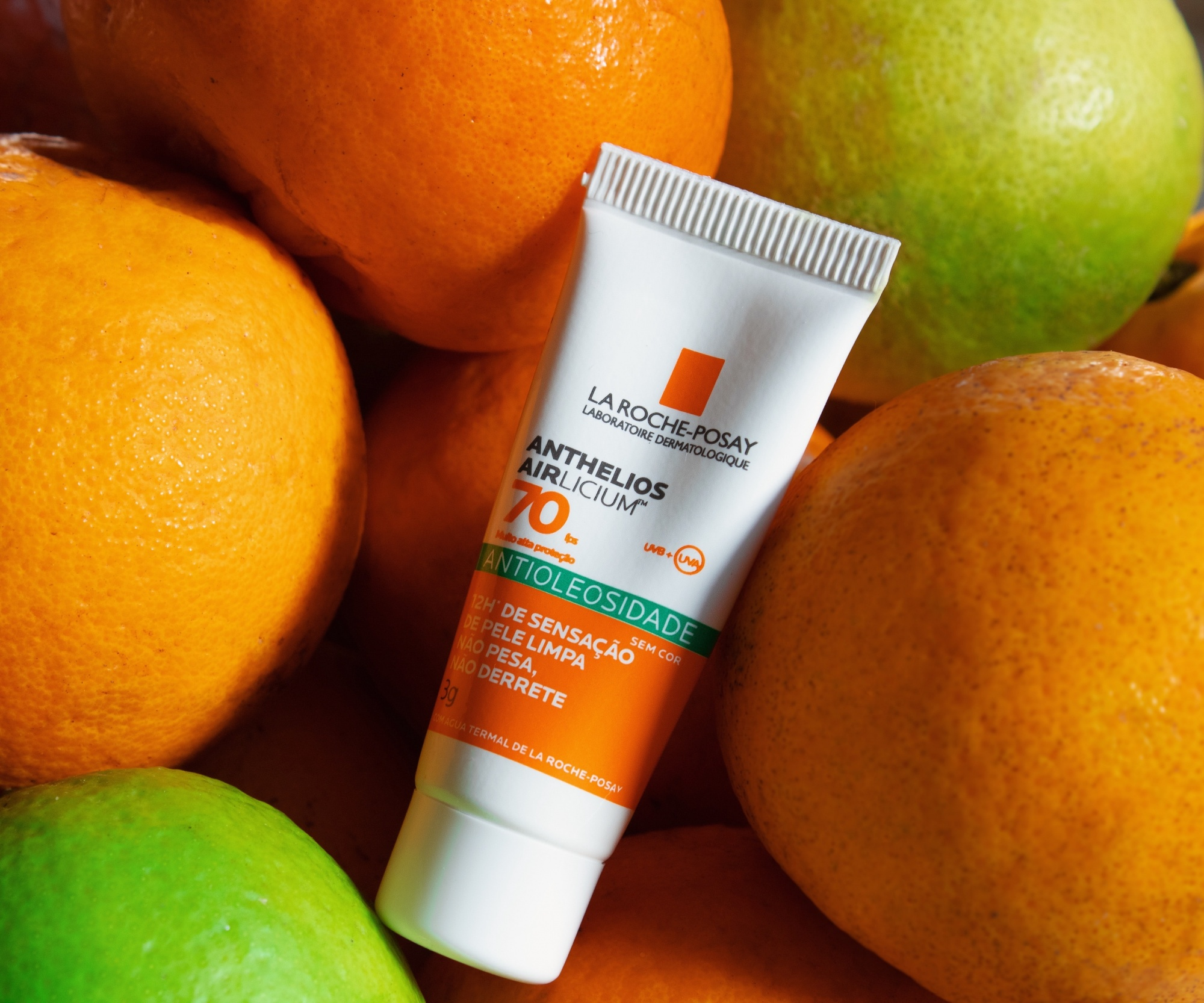 how to reduce hyperpigmentation, hyperpigmentation solutions sunscreen tube in orange and white by La Roche-Posay