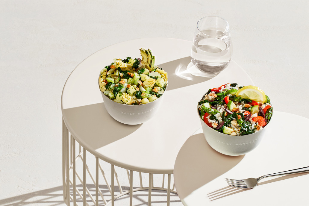 best meal delivery services, Daily Harvest bowls of food and glass of water on a white table with white background