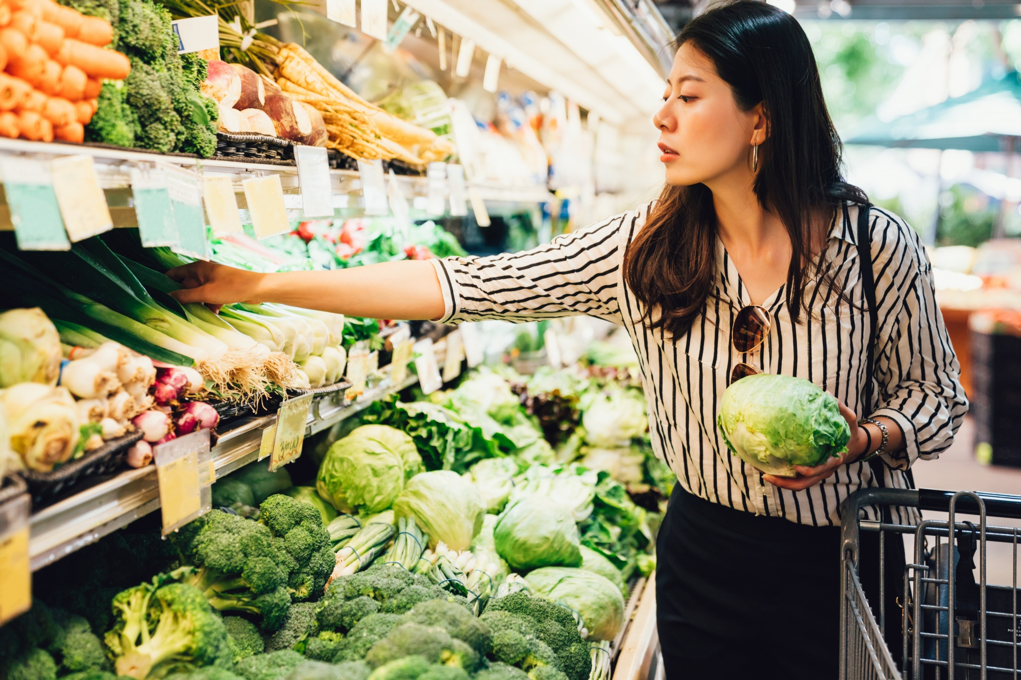 get rid of mummy tummy for good, Asian woman choosing vegetables at store