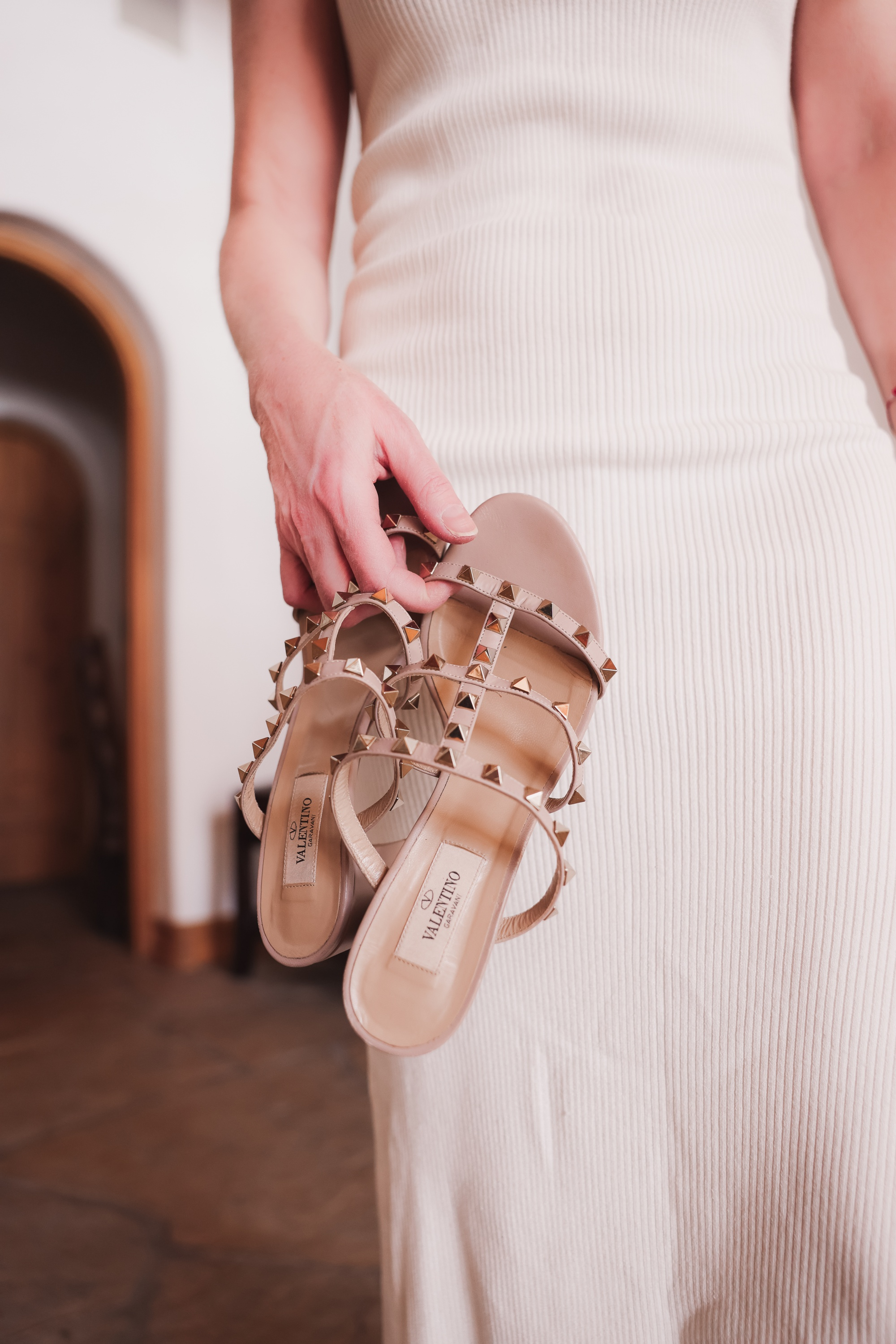Valentino Rockstud sandals in beige paired with white knit tank dress