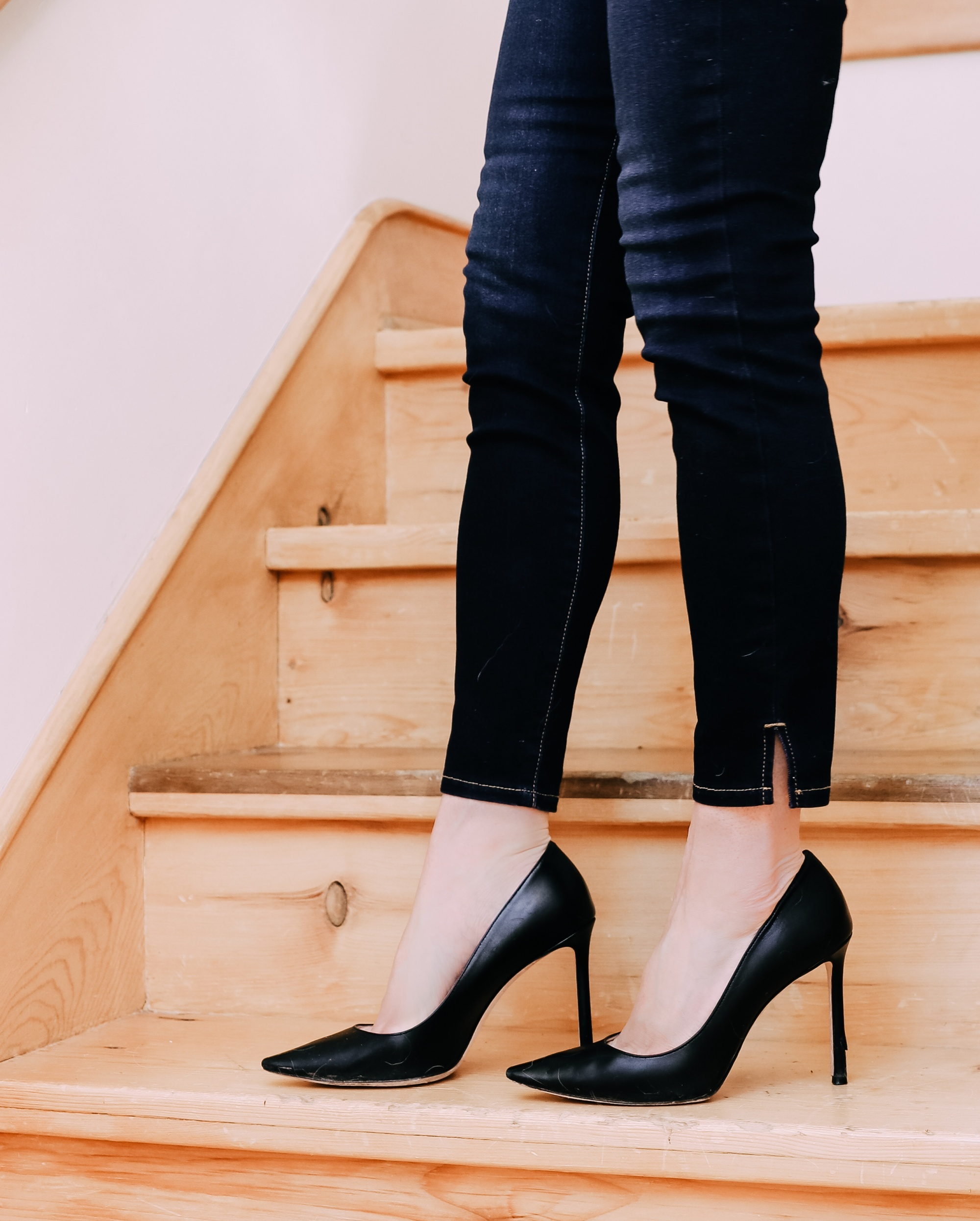 what shoes to wear with jeans featuring Jimmy Choo Romy pumps in black leather paired with dark wash skinny jeans and a black lace corset top by Jonathan Simkhai on fashion over 40 blogger Erin Busbee