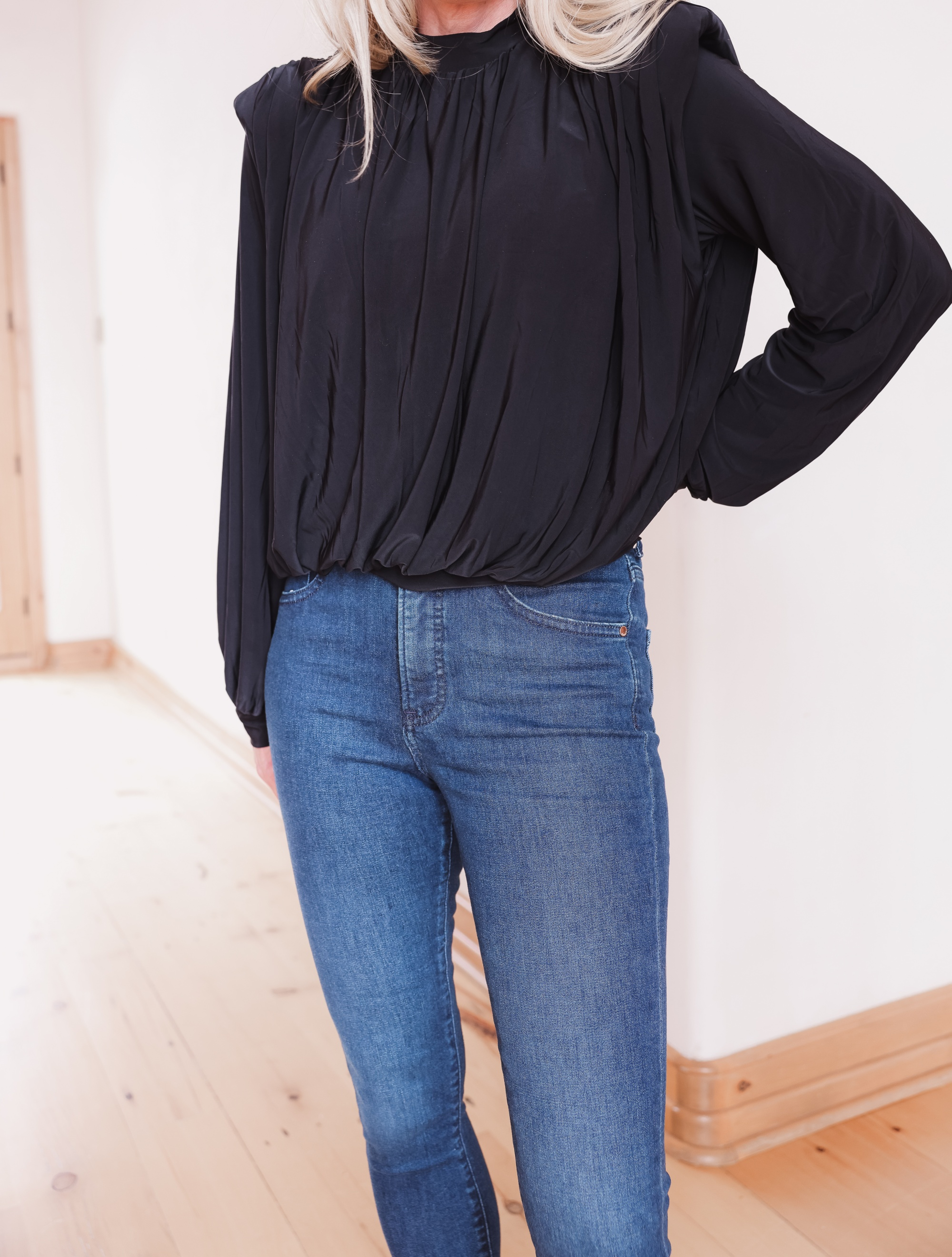 t-shirt trend, padded shoulder top, express padded shoulder blouse, erin busbee, black slouchy booties, high rise jeans, express denim