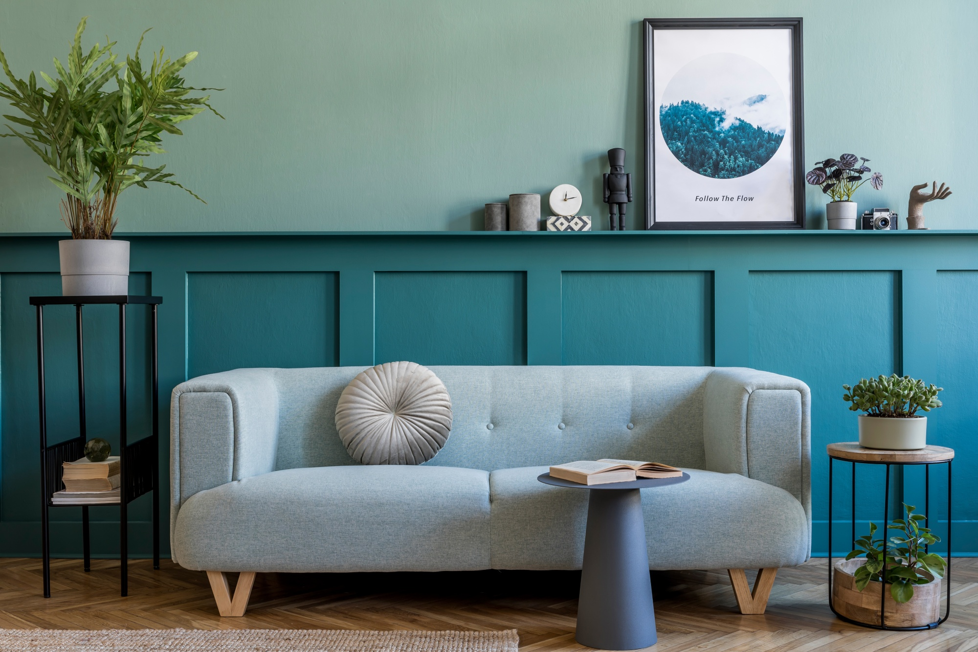 Japandi design muted green wall mixed with neutral colored couch and decor