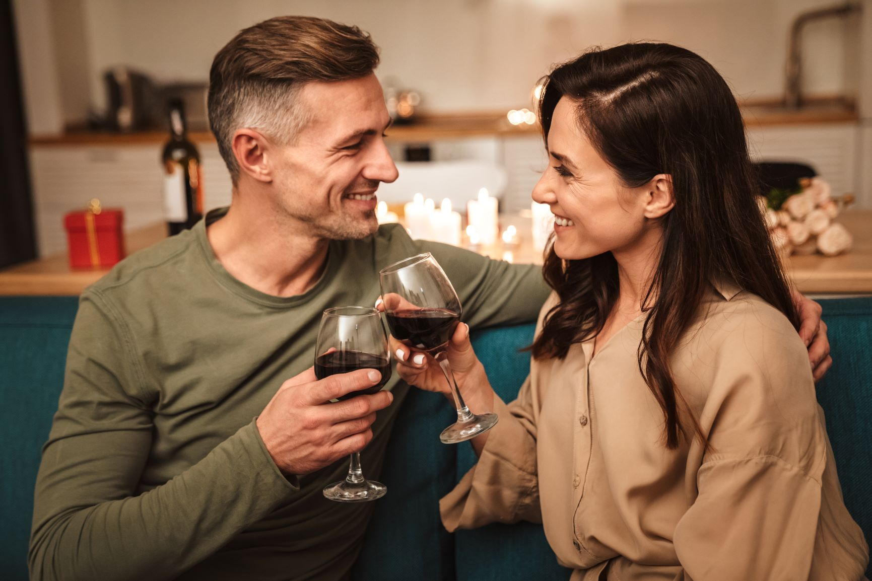 better sex after menopause Middle aged couple toasting with red wine
