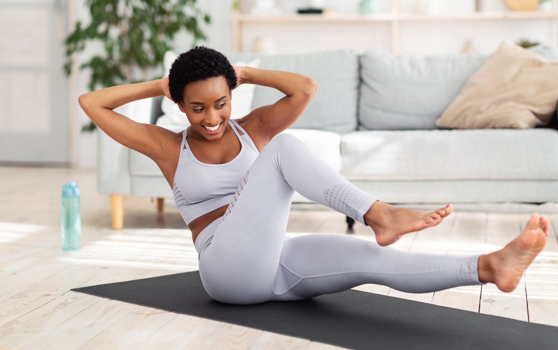 get rid of mummy tummy for good, Short-haired Black woman core strength