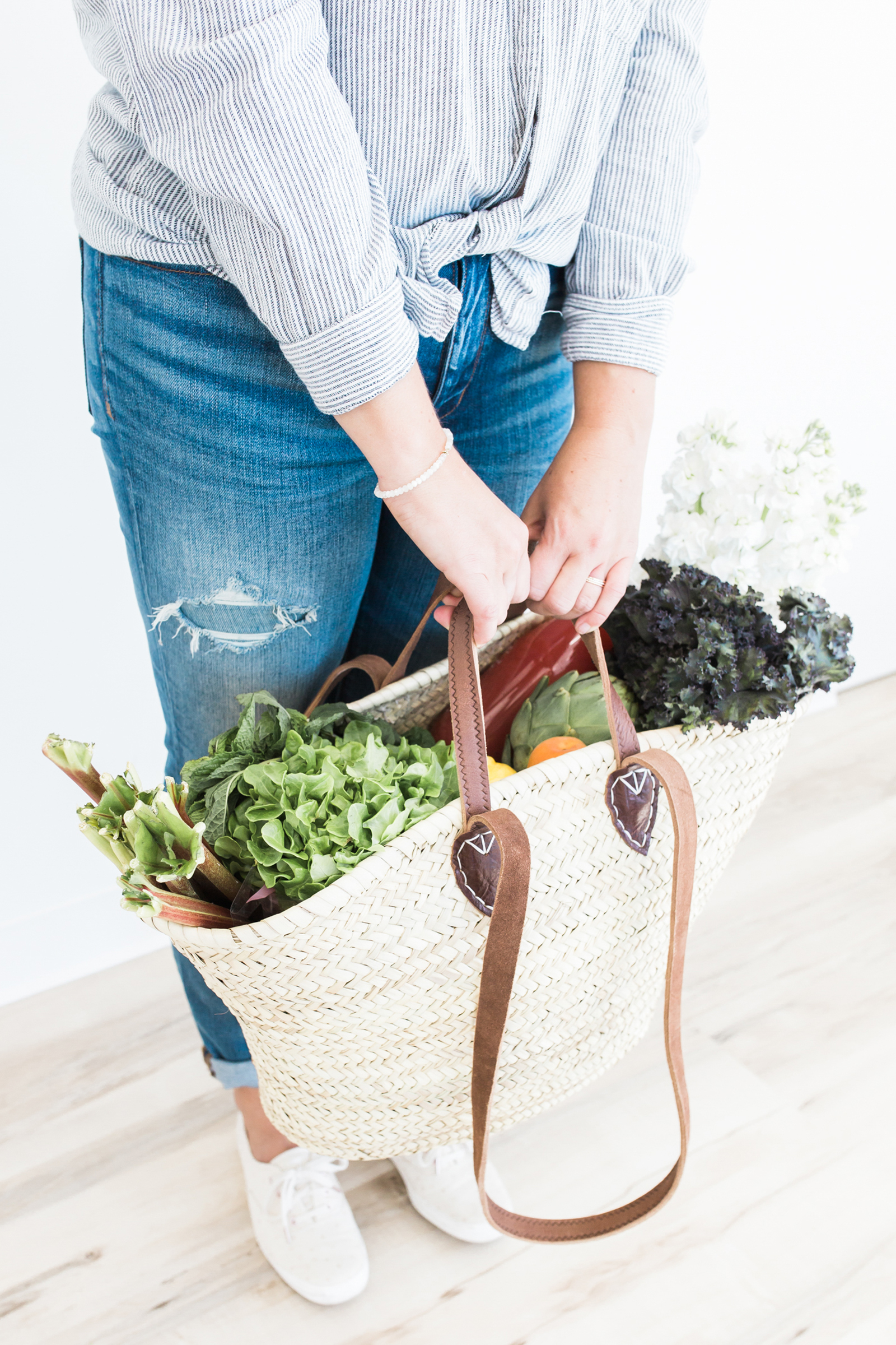 get rid of mummy tummy for good Woman with large wicker tote of vegetables