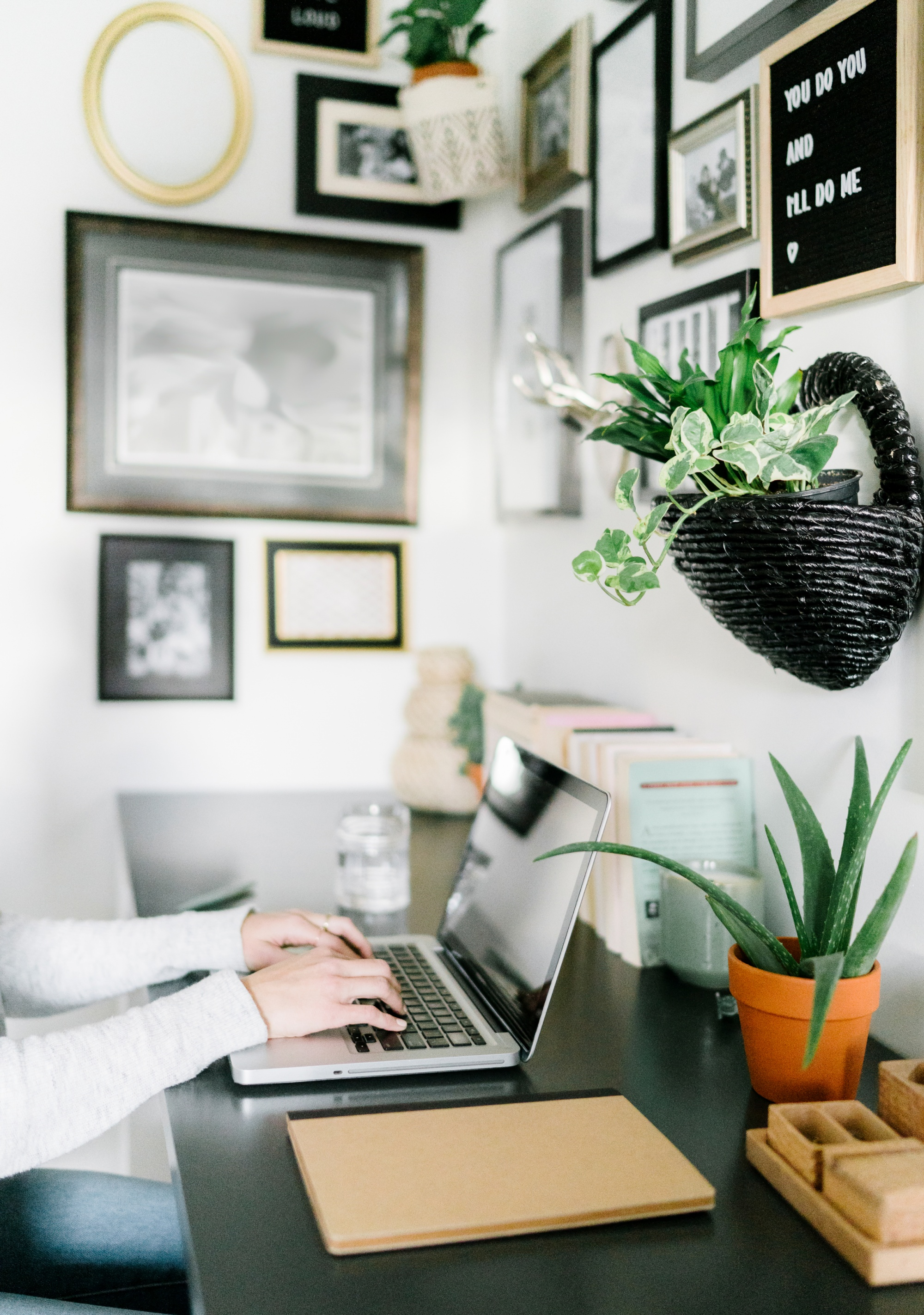 Why The Cloffice is the Best Work From Home Setup small desk with woman typing on keyboard