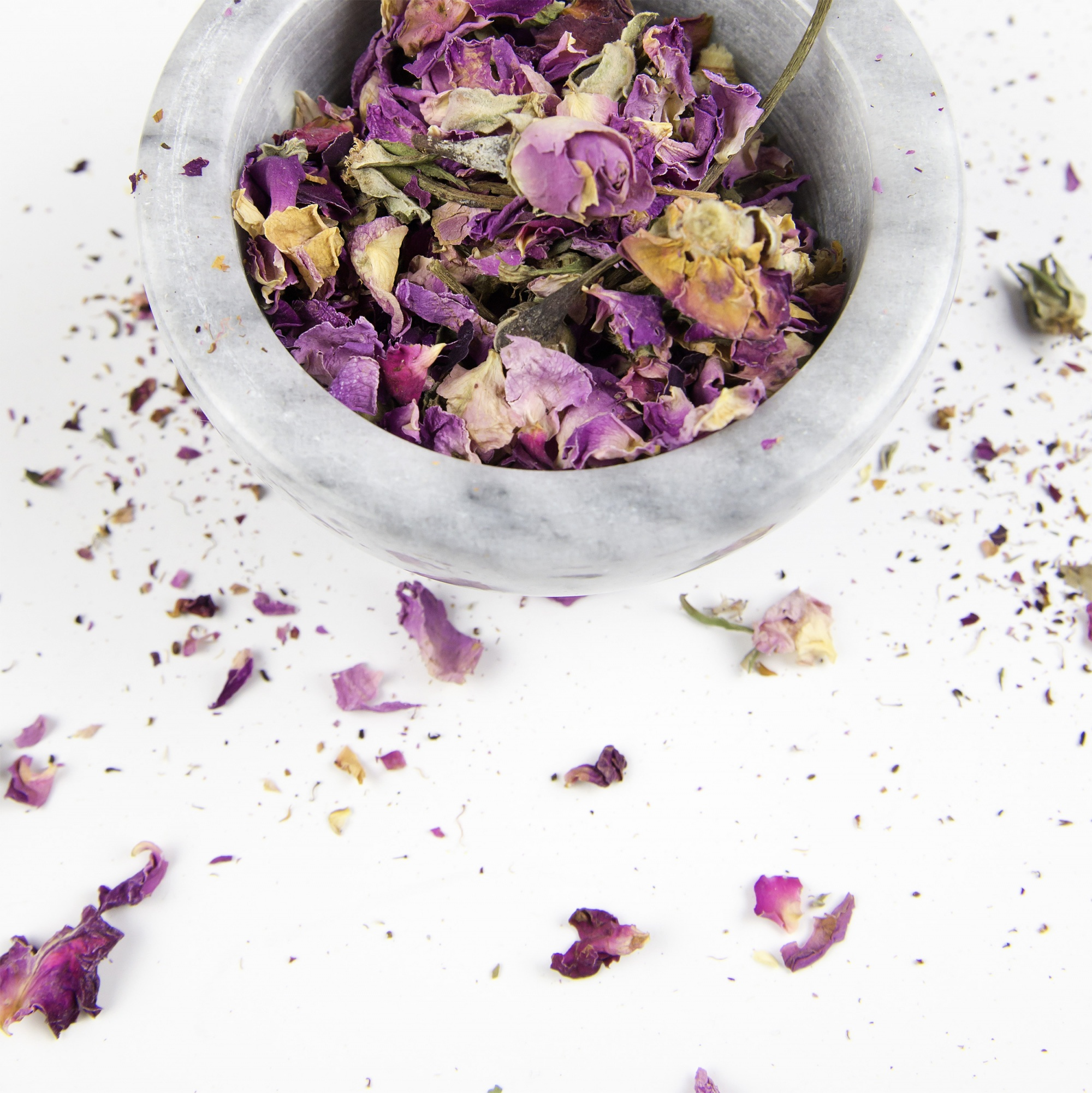 better sex after menopause, pink and purple petals in white marble bowl essential oils
