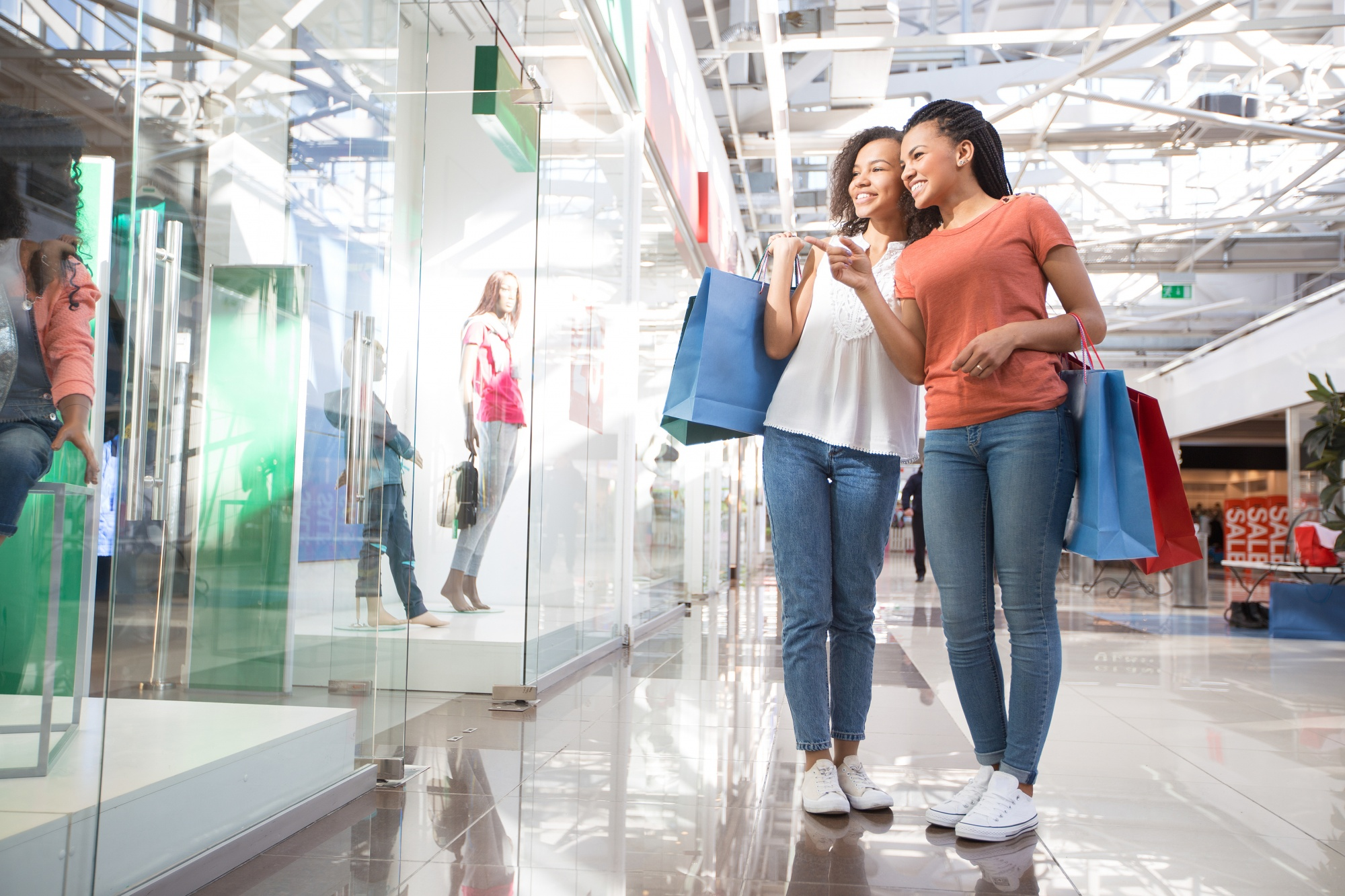 budget for when you have teens, two African American girls, friends window shopping at a mall
