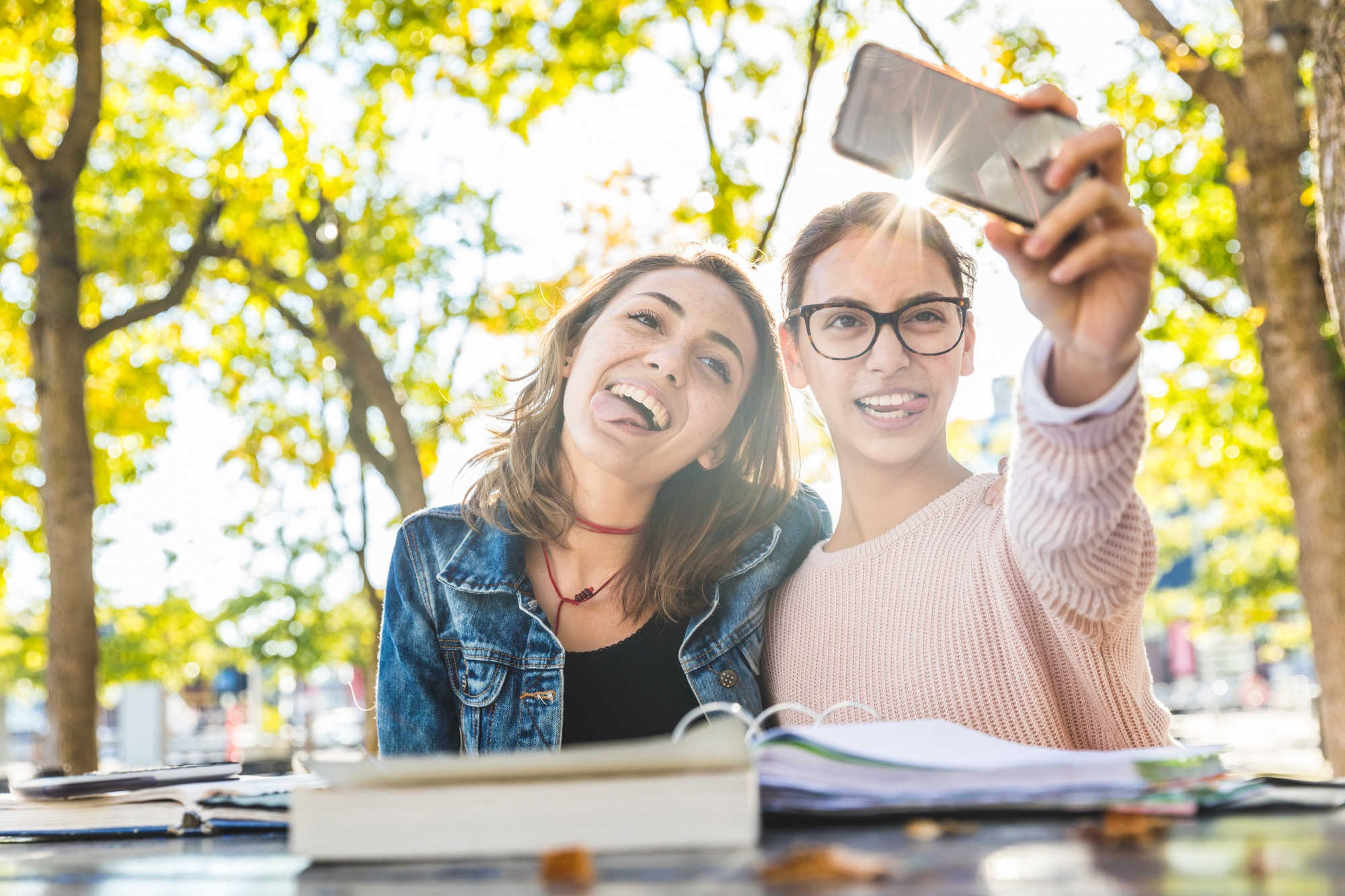 budget for when you have teens, two girlfriends taking a selfie outdoors making silly faces