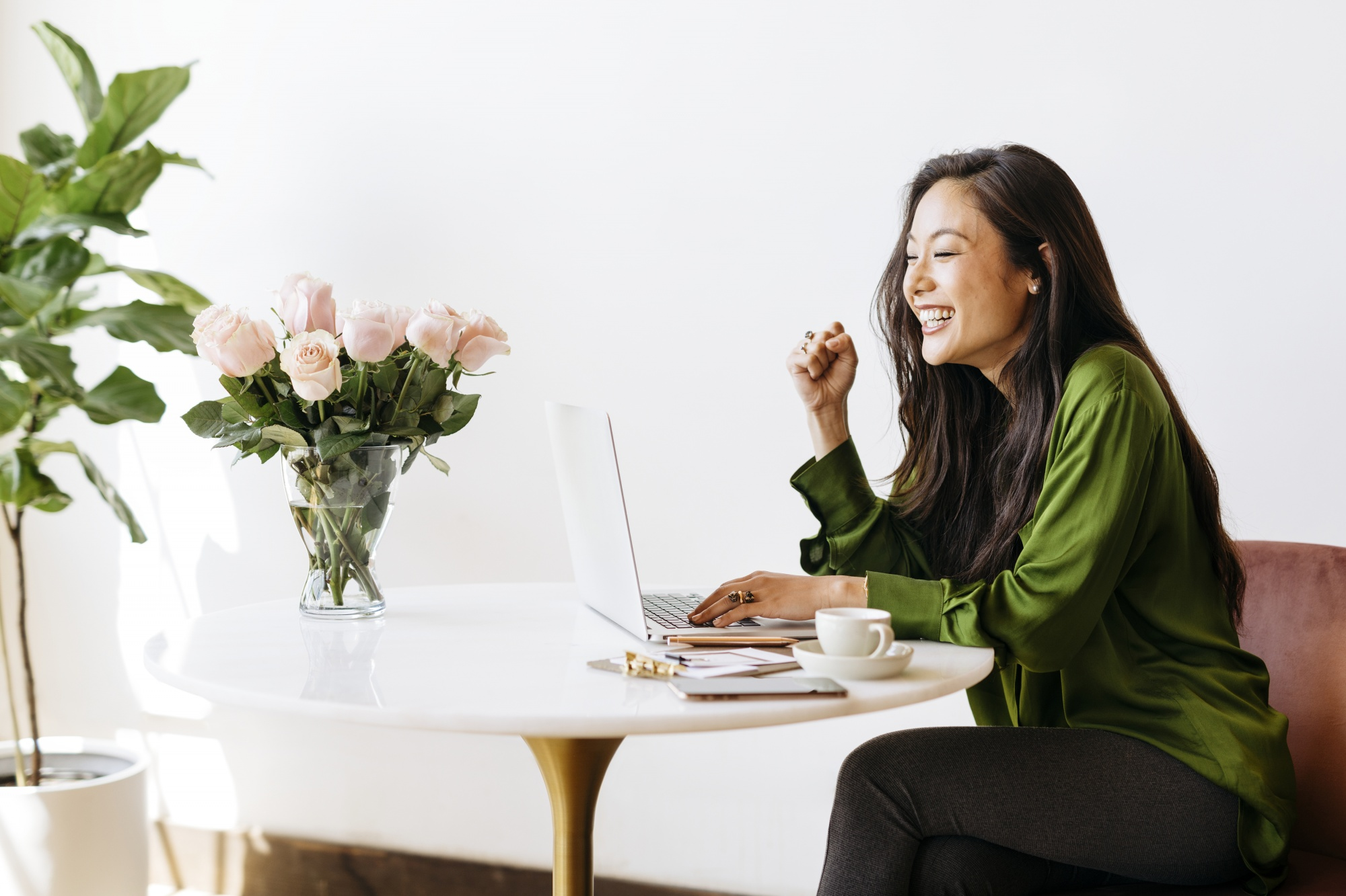 dating profile after 40, Asian woman smiling happy while writing on laptop