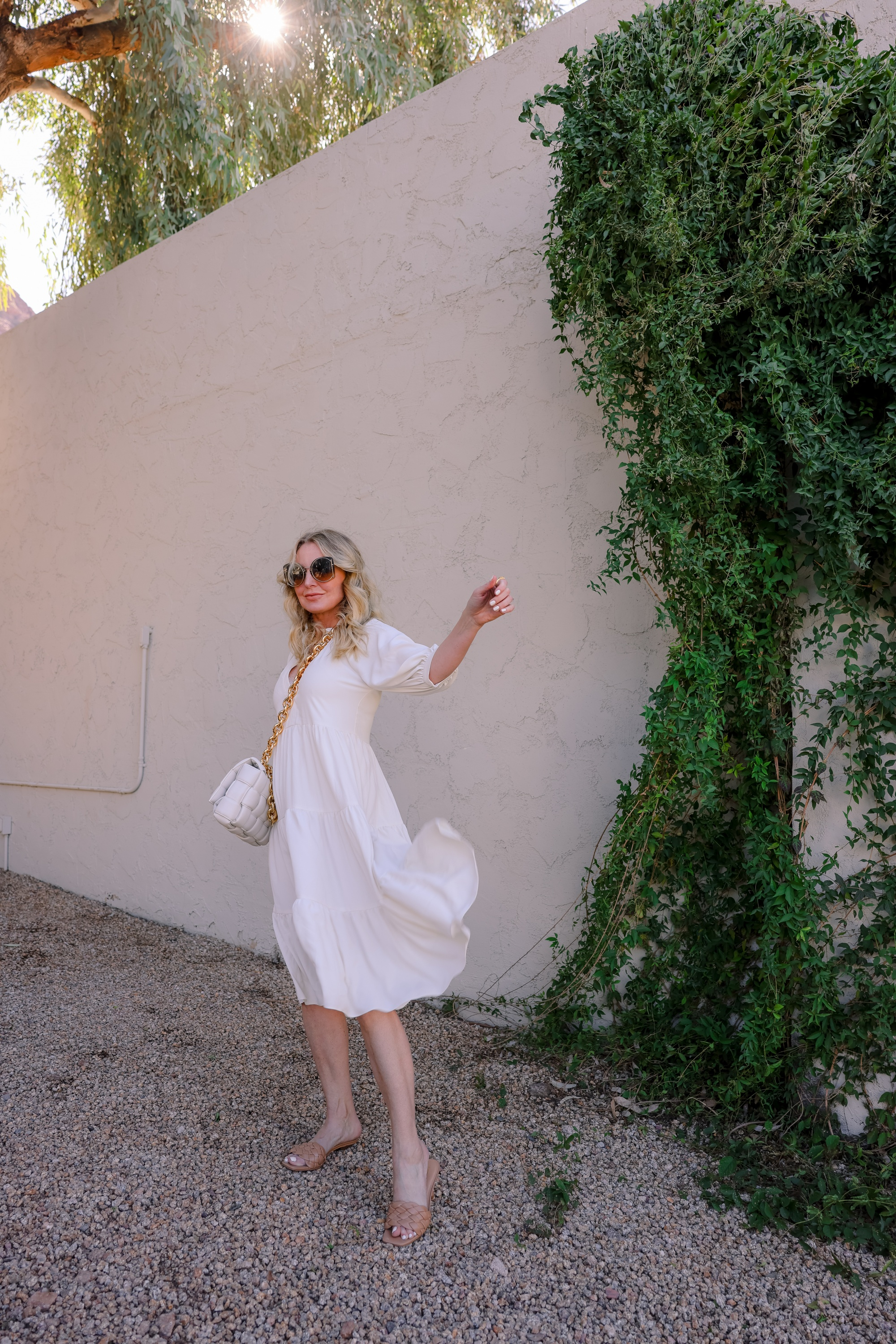 White dresses for spring! Featuring a beautiful white midi length white dress by Amanda Uprichard on fashion over 40 blogger Erin Busbee