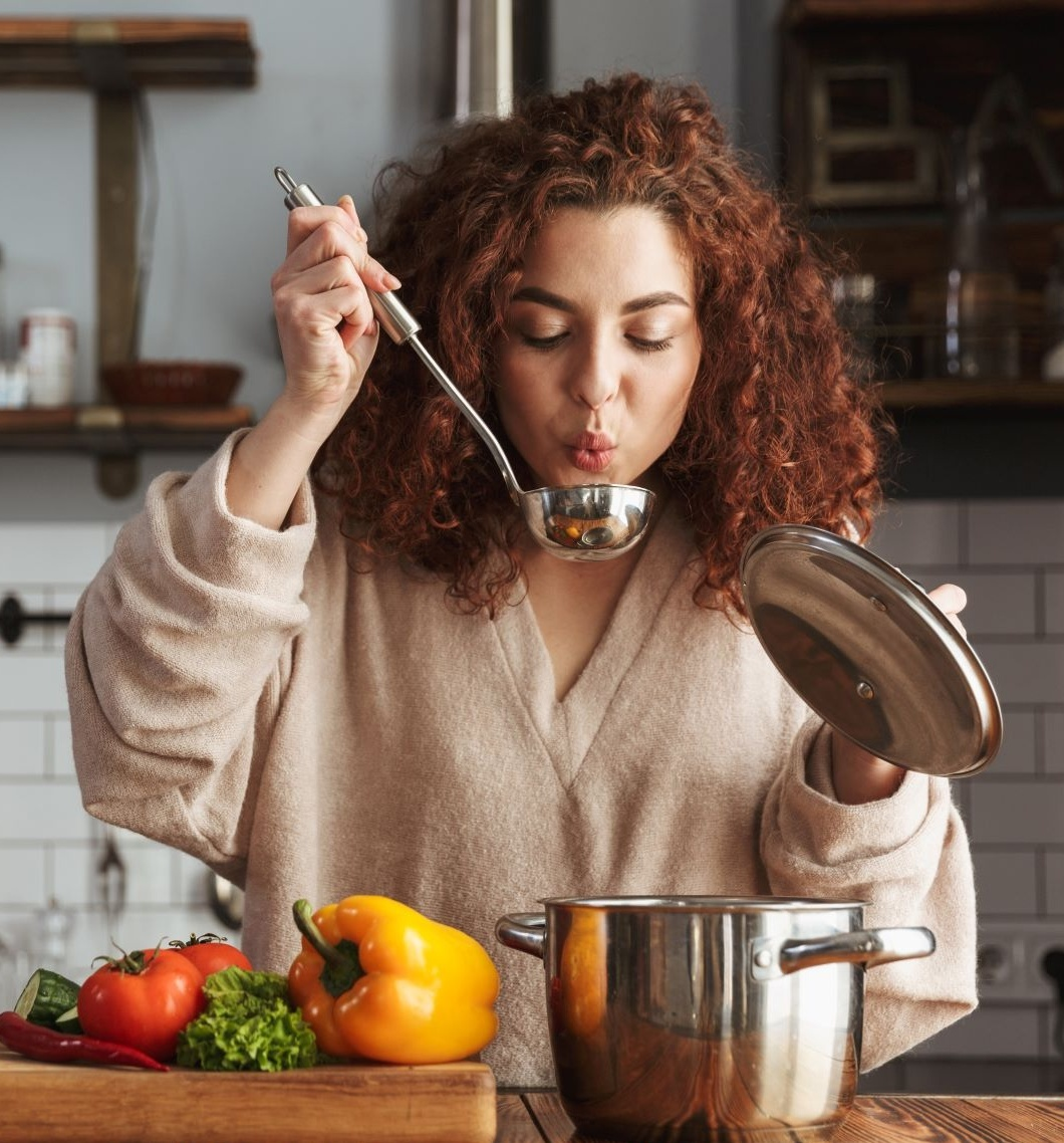 Supercharge your metabolism woman making making soup with ladle in hand