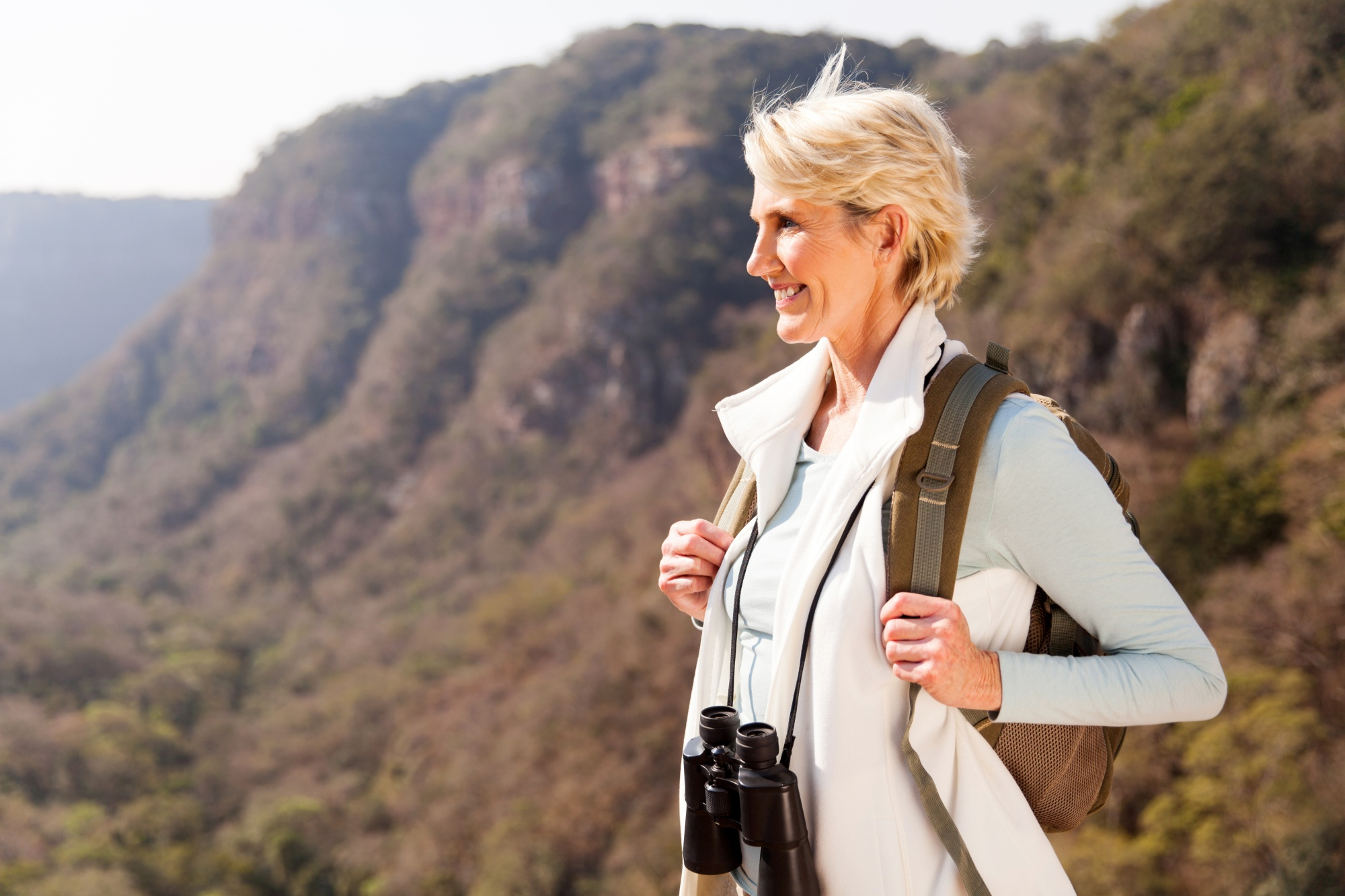 why reinventing yourself makes you younger, beautiful hiker enjoying the view from top of a mountain