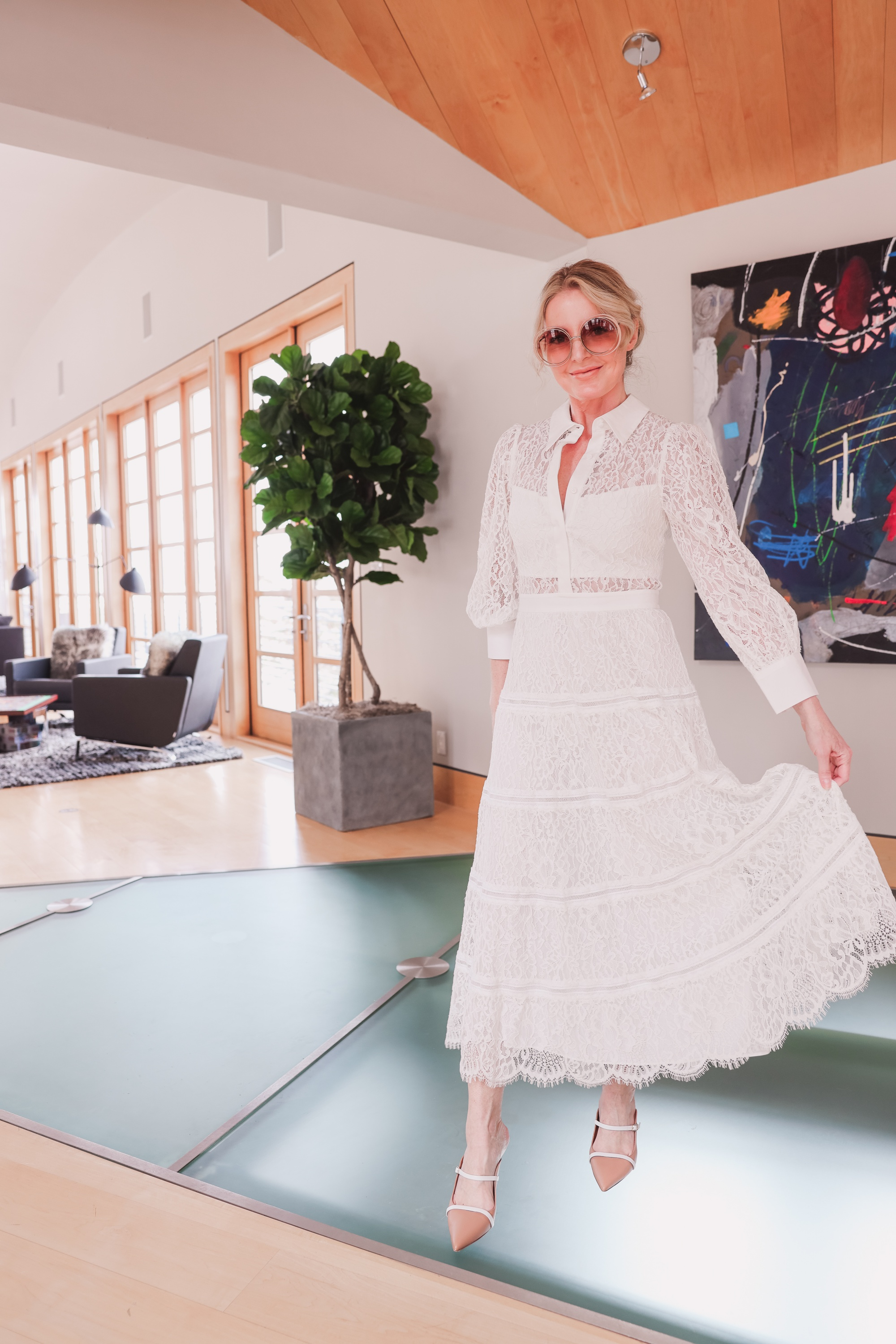 Sexy and elegant sheer white lace dress by Alice + Olivia paired with Malone Souliers mules and Chloe round sunglasses on fashion over 40 blogger ERin Busbee in Telluride, Colorado