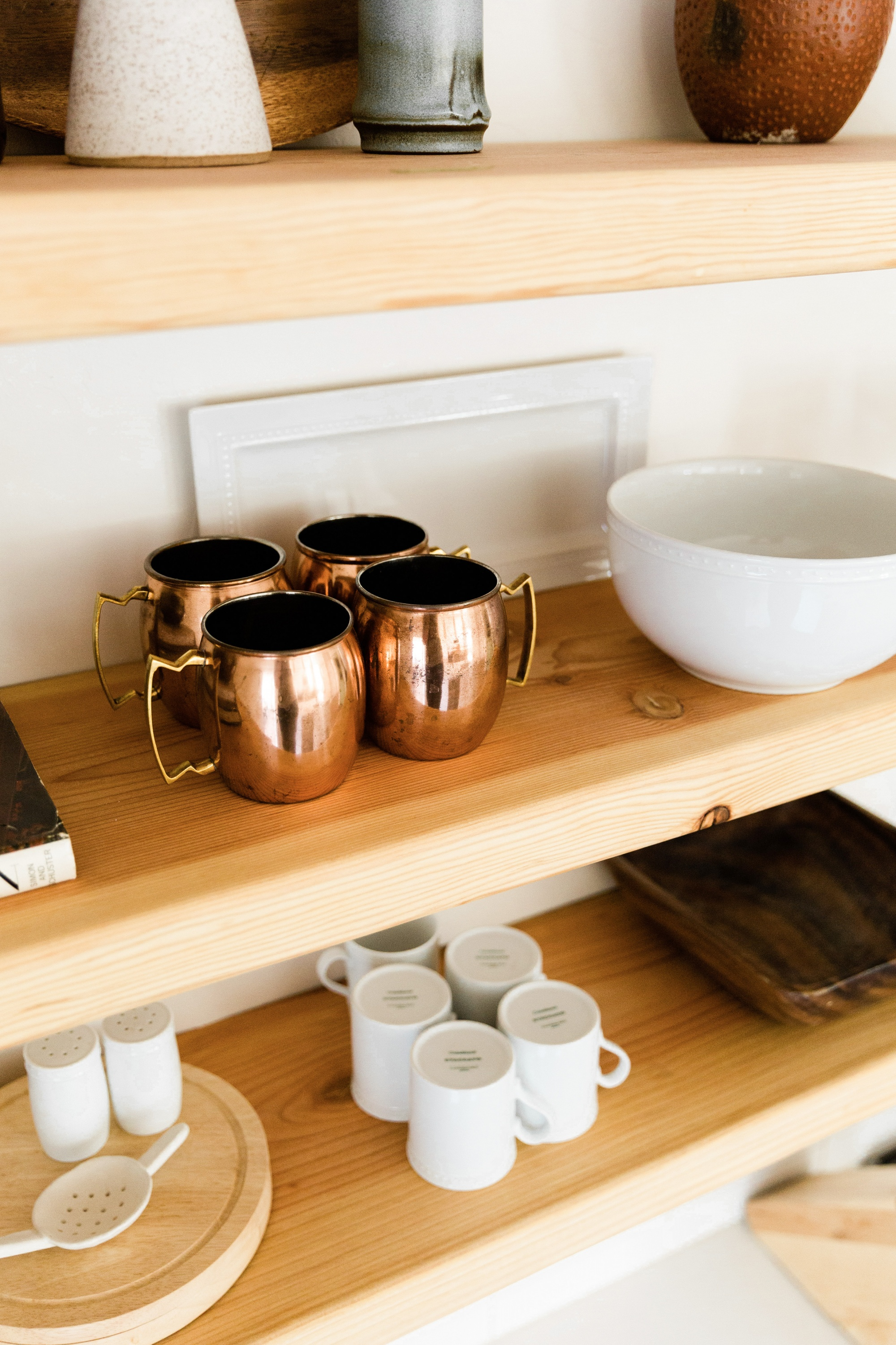 How To Style Pinterest-Worthy Floating Kitchen Shelves mugs and bowls on a shelf
