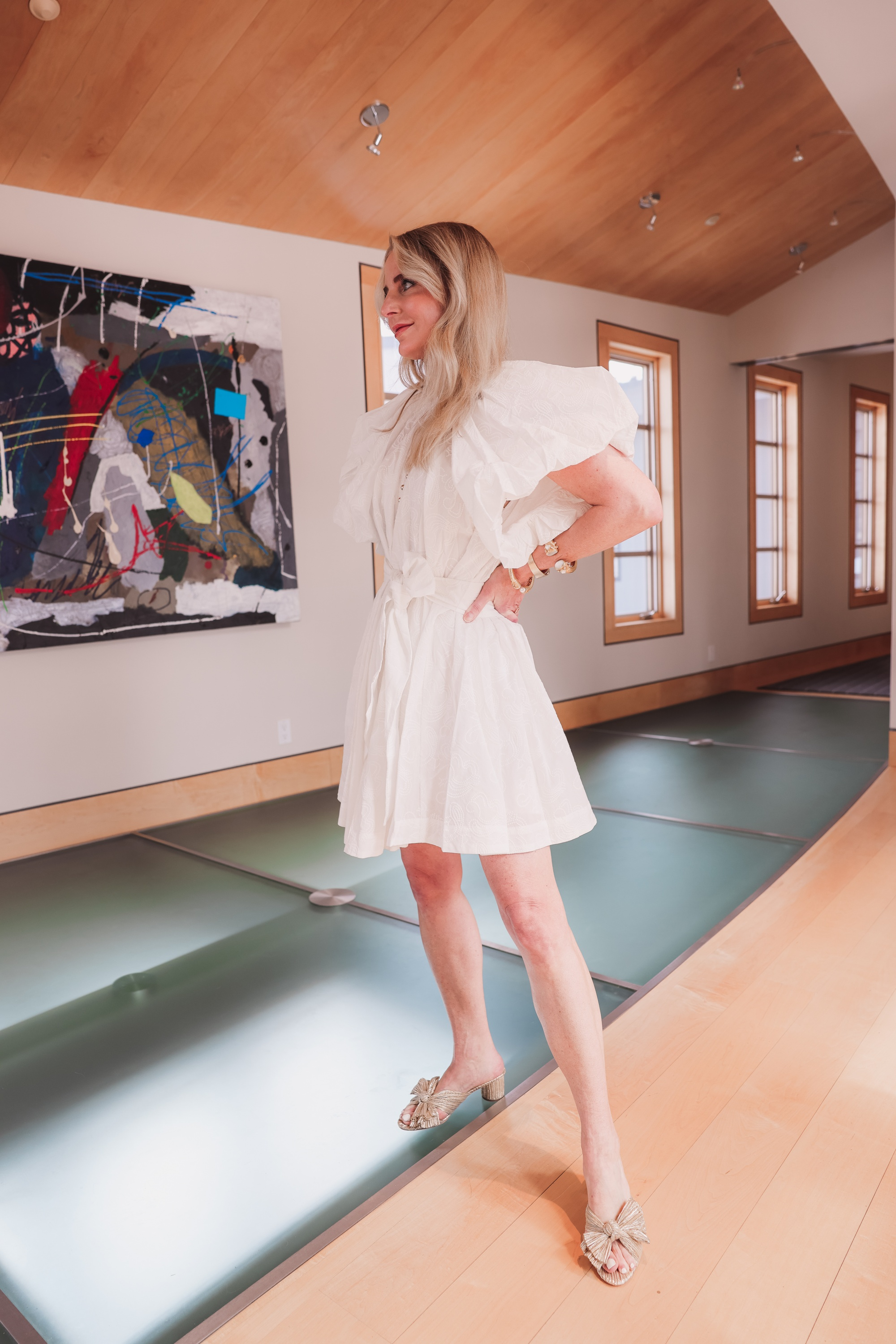 spring shoes, shoe trends spring 2021, best spring shoes, spring shoe styles, shoes for spring, summer shoes, summer sandals, summer shoes list, erin busbee, white alcer puff sleeve gold button dress, Loeffler Randall gold sandals