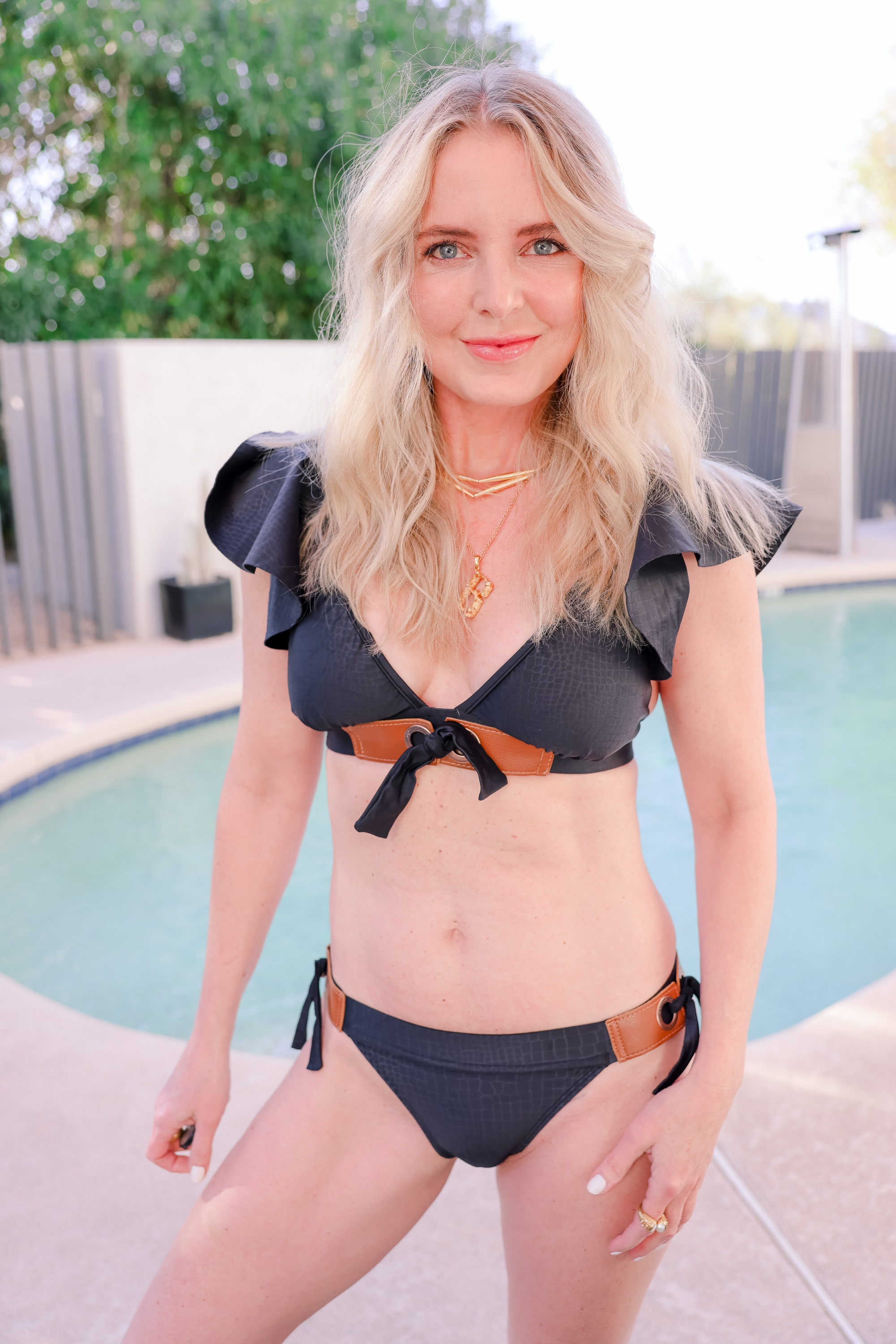 best bikinis over 40, black and leather agua de coco bikini, erin busbee, swimwear for ladies over 40, flattering swimsuits, best swimsuits for body type, swimwear over 40