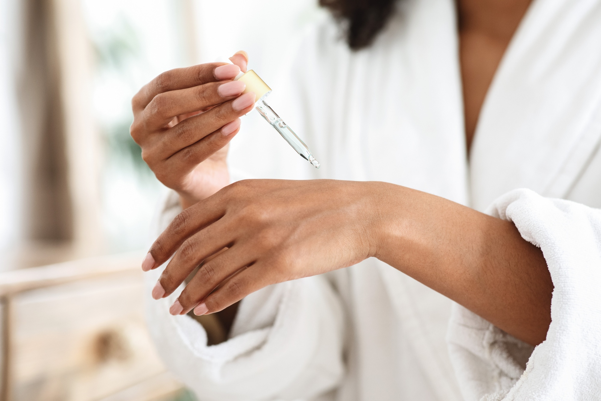 dry skin dropper in hand common beauty questions