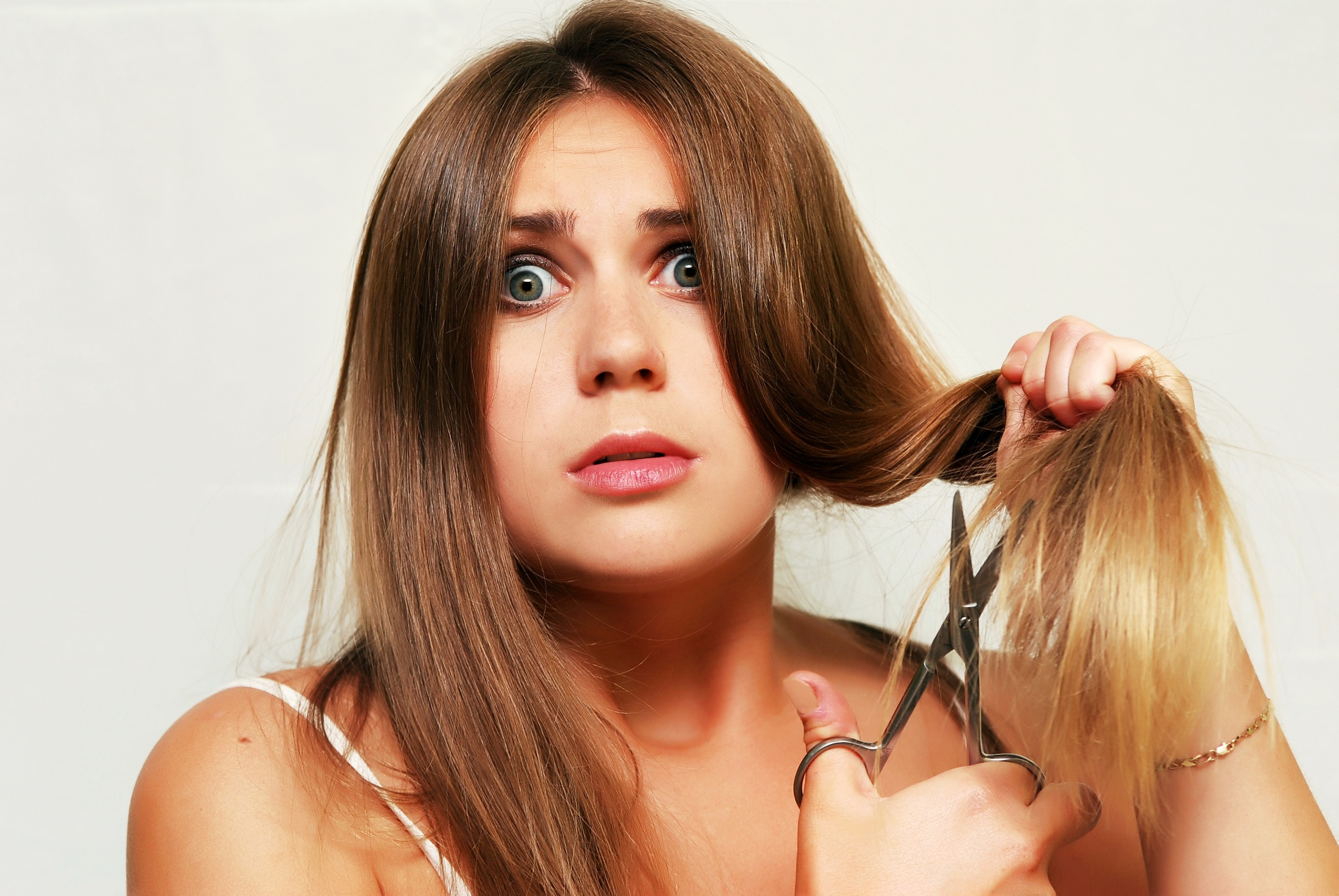 woman cutting her own hair common beauty questions