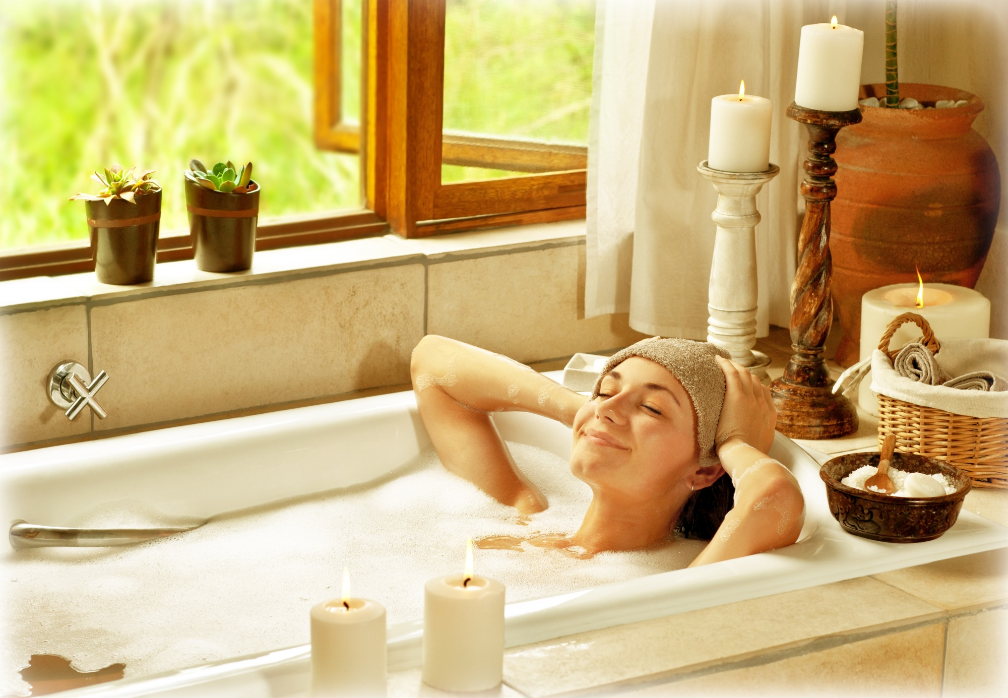 Woman with dark hair taking a relaxing bubble bath - Best things for a relaxing bath, you deserve a relaxing bath, how to have a relaxing bath
