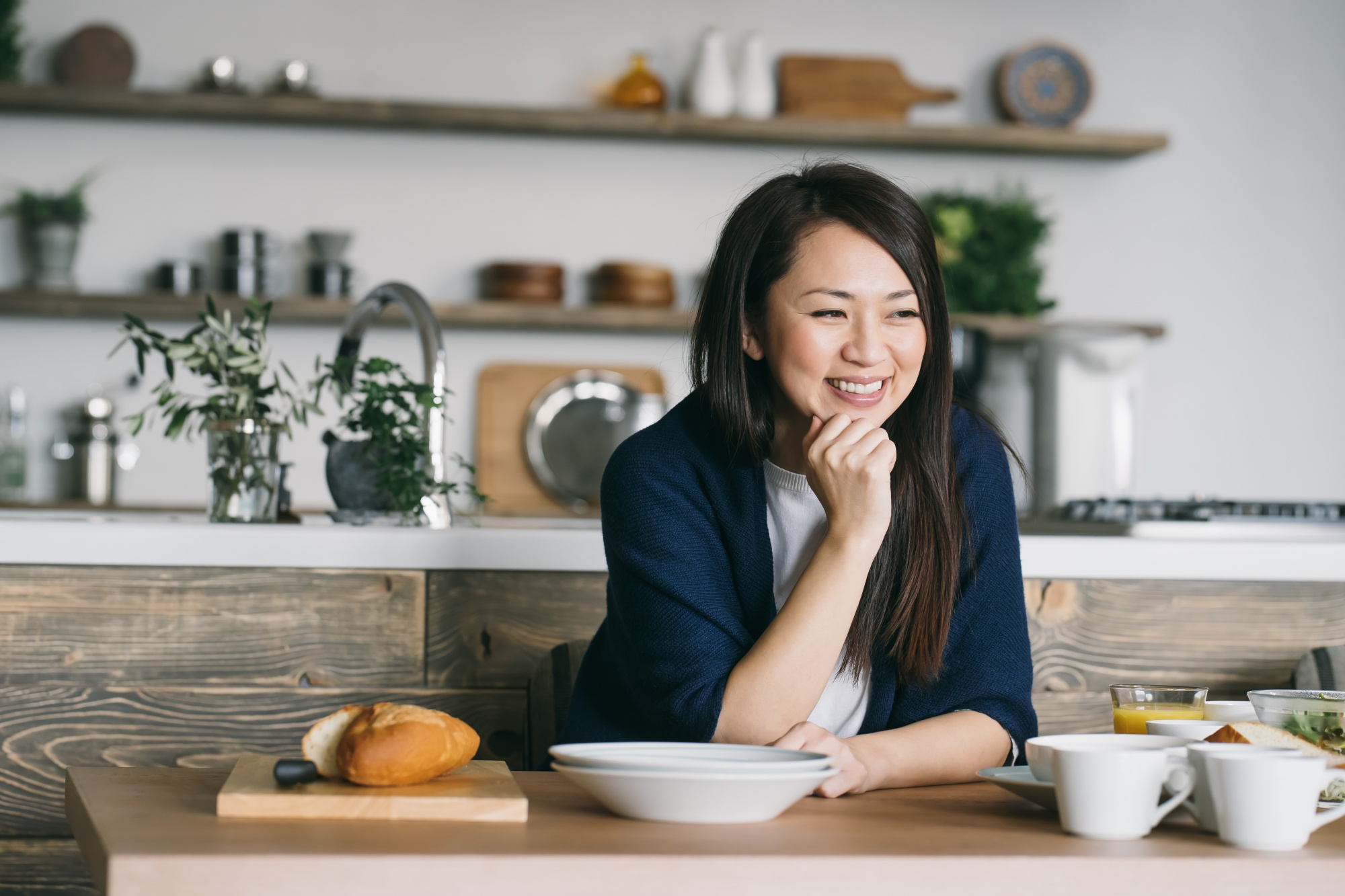 intermittent fasting & intuitive fasting, Asian woman at counter in navy cardigan