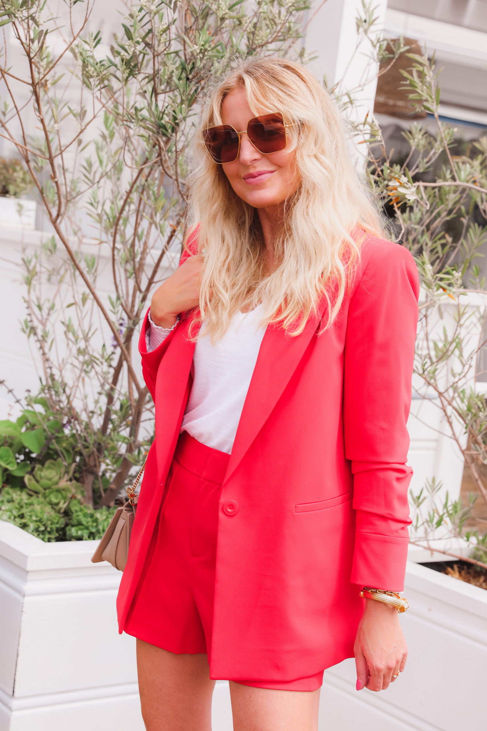 shorts suit in red by Alice + Olivia on fashion over 40 blogger Erin Busbee in Malibu California