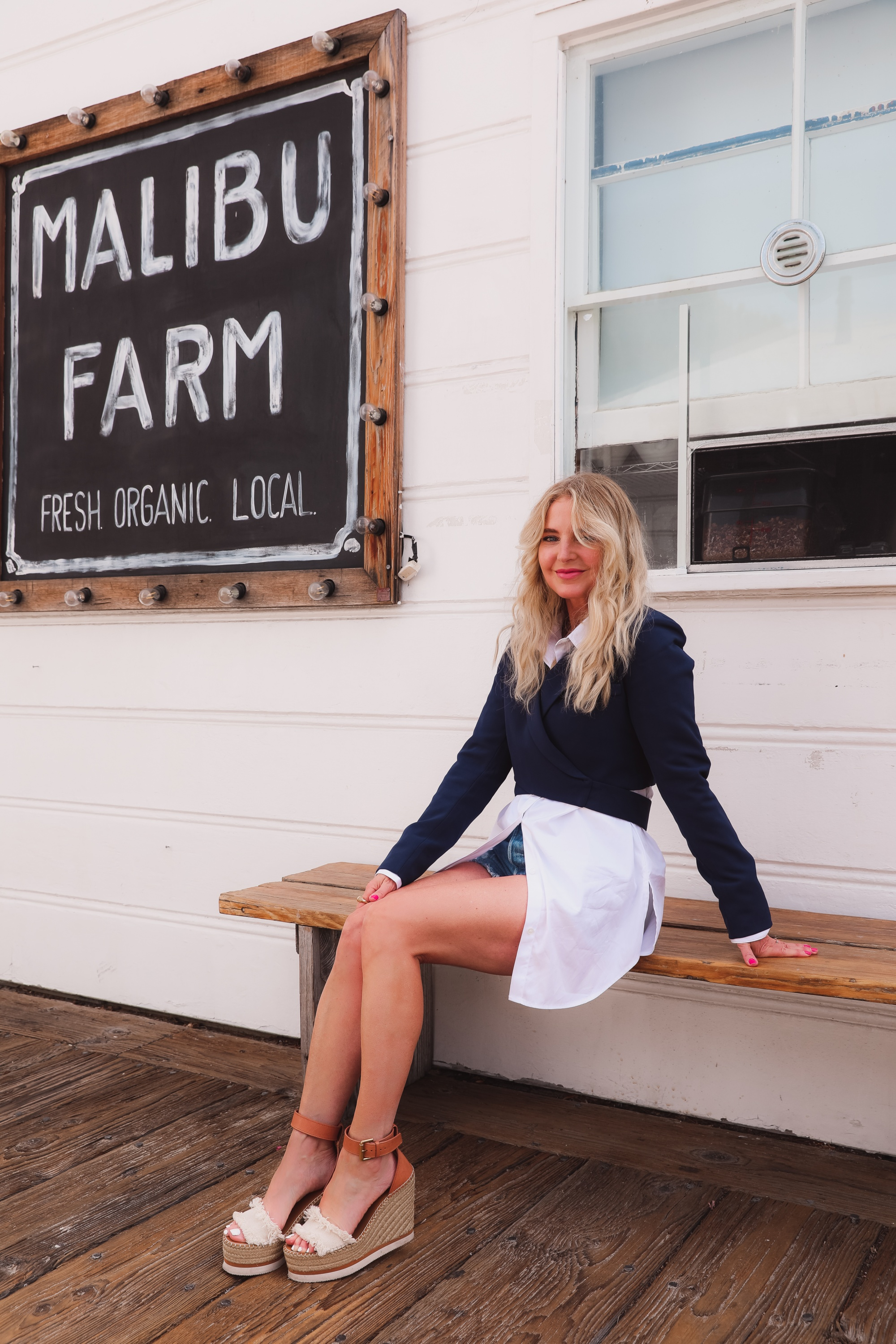 how to wear a cropped blazer, how to wear a cropped blazer over 40, how to wear cropped blazer, wear cropped blazer, navy cropped blazer, 4th & reckless cropped blazer, white open edit oversized button down, see by chloe wedges, denim shorts, levi shorts, cropped blazer outfit, erin busbee