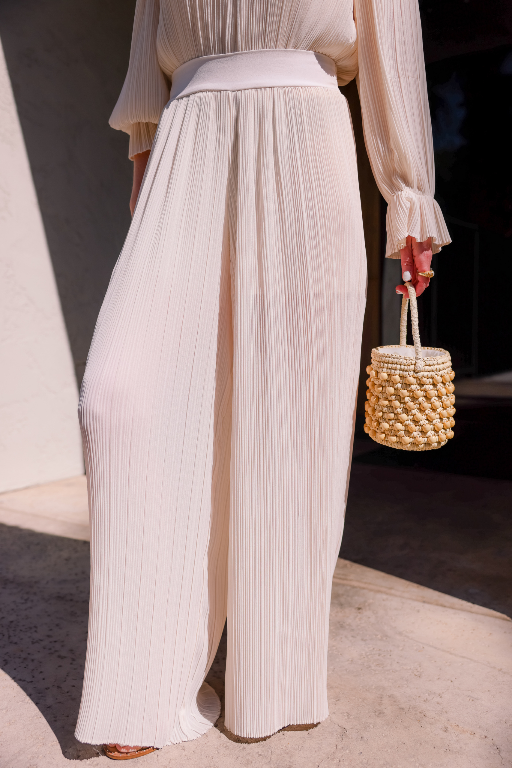 hemline length of pants featuring white pleated pants