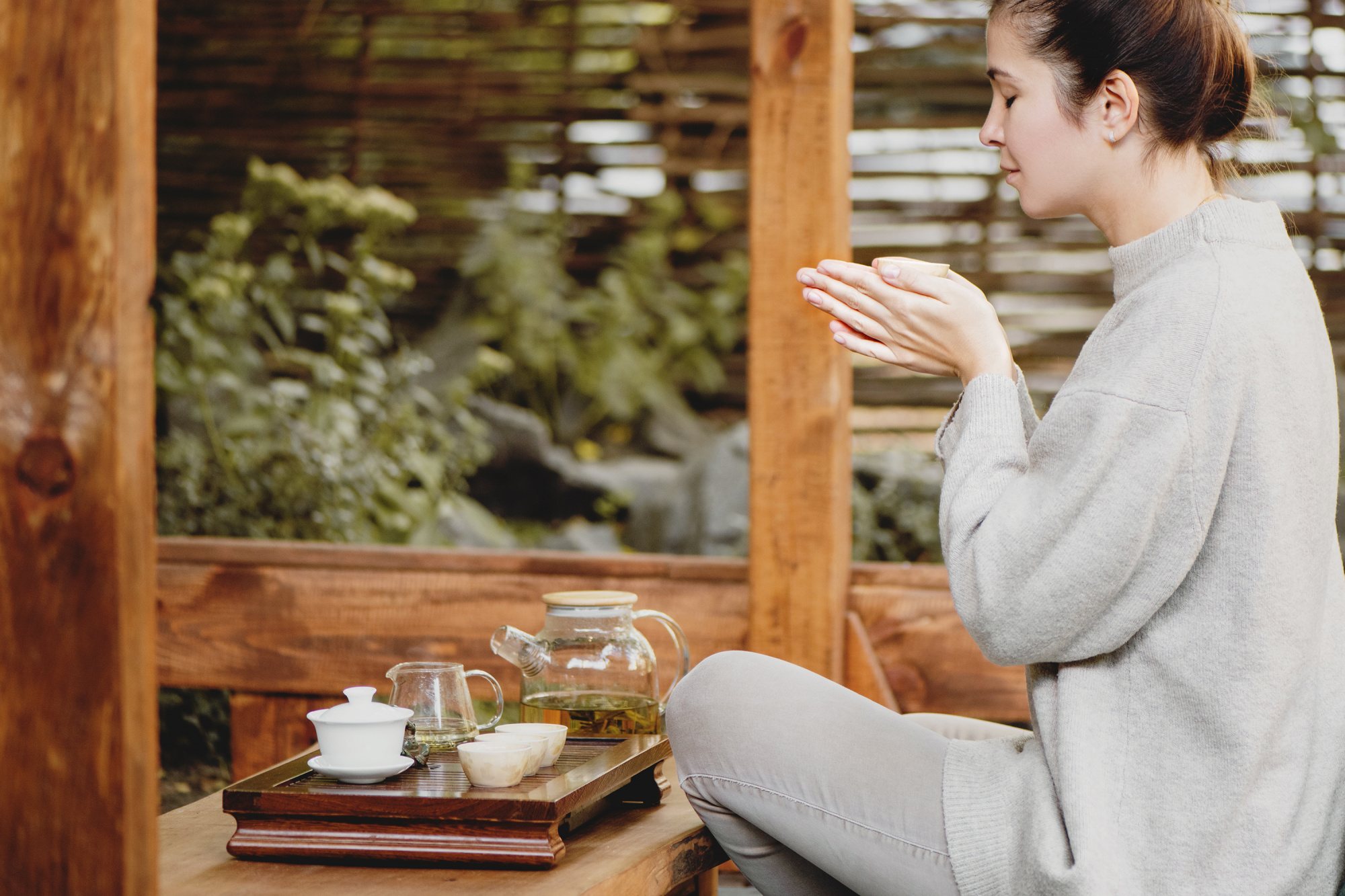 common menopause questions, Brunette in grey performing tea ritual
