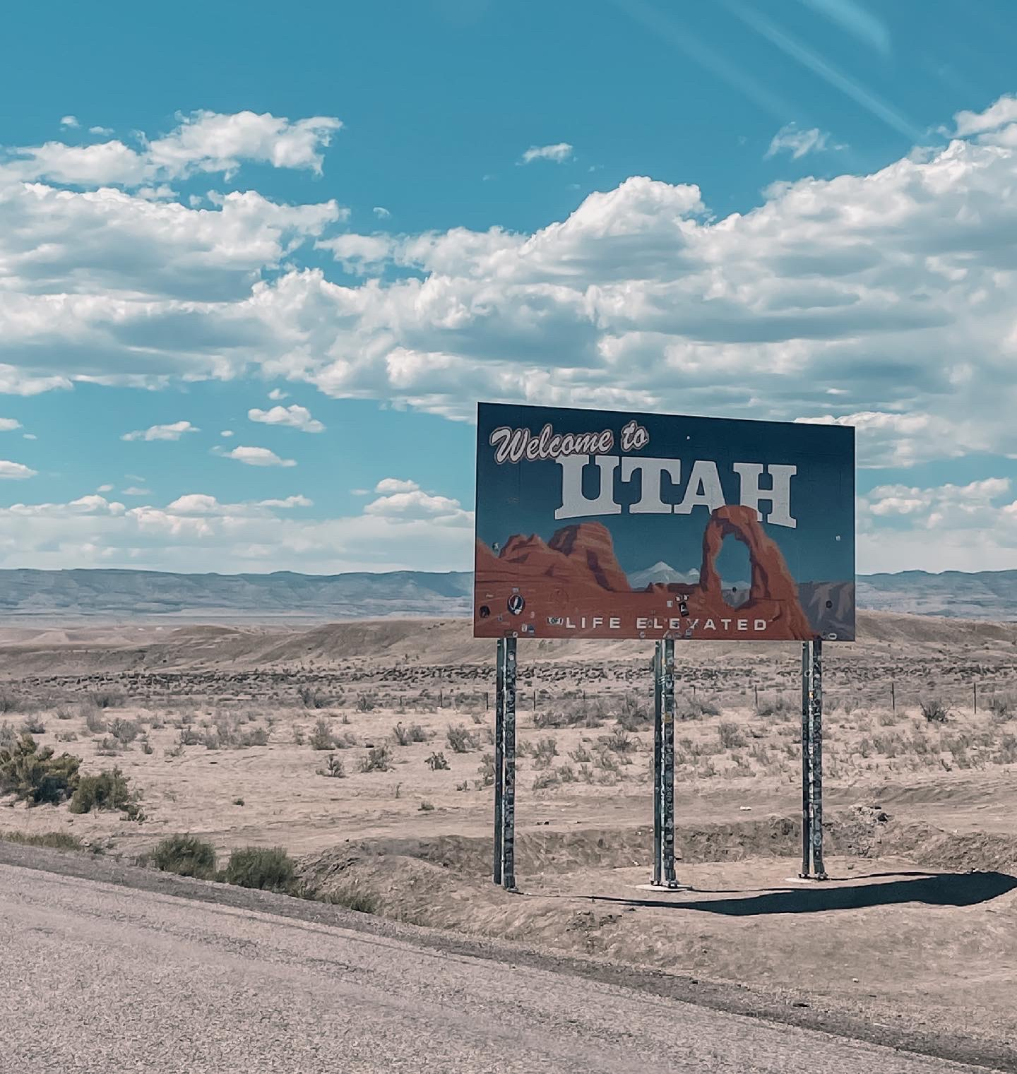 where to stop on a cross-country road trip, best places to stop on a cross country road trip, cross country road trip, west coast to east coast road trip, erin busbee, utah state line, park city utah