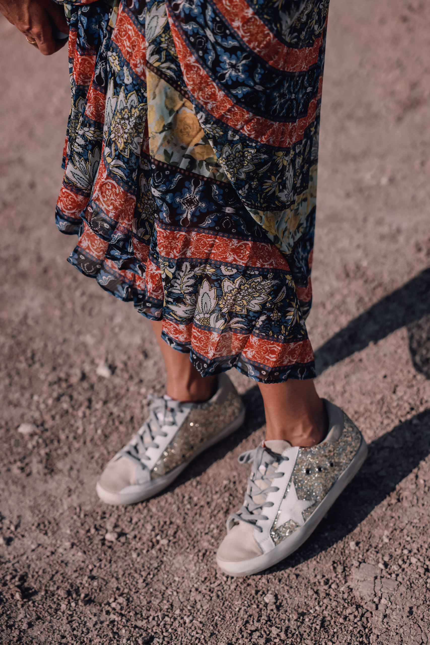 maxi skirts, maxi skirts over 40, printed pleatd maxi skirt, alice + olivia maxi skirt, erin busbee, how to wear maxi skirts, free people wire v-neck bodysuit, gold glitter golden goose sneakers