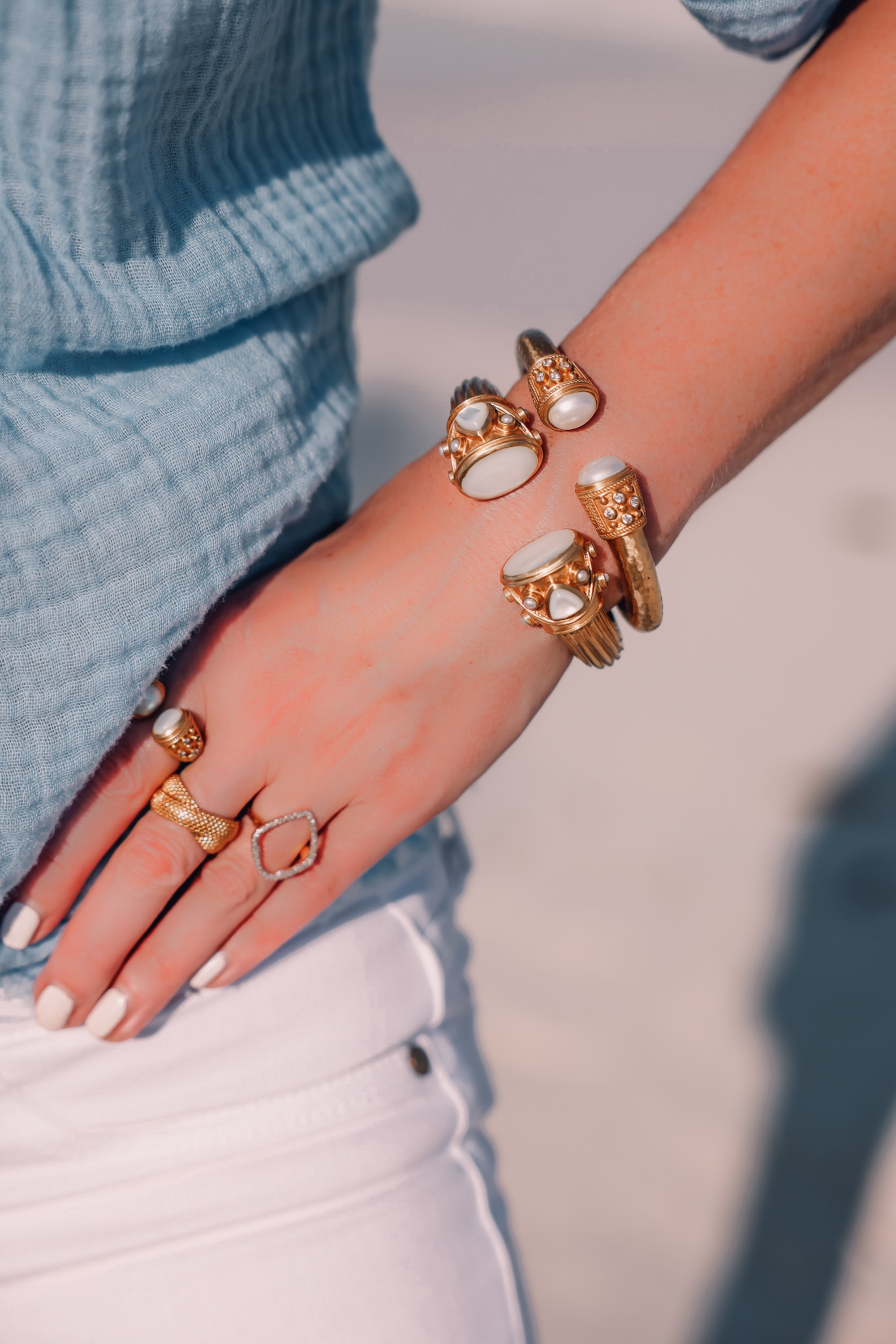 accessories for beach vacation featuring hinge bracelets by Julie Vos and rings by Monica Vinager