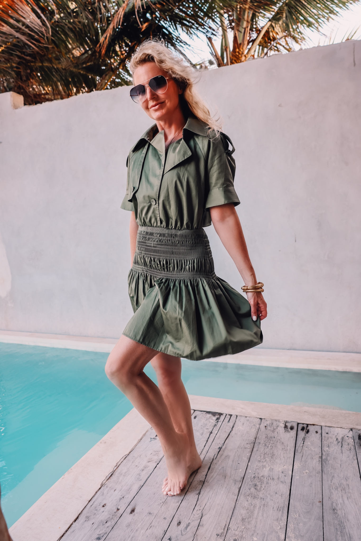 dark green self-portrait trench dress with smocking on fashion over 40 blogger Erin Busbee in Mexico