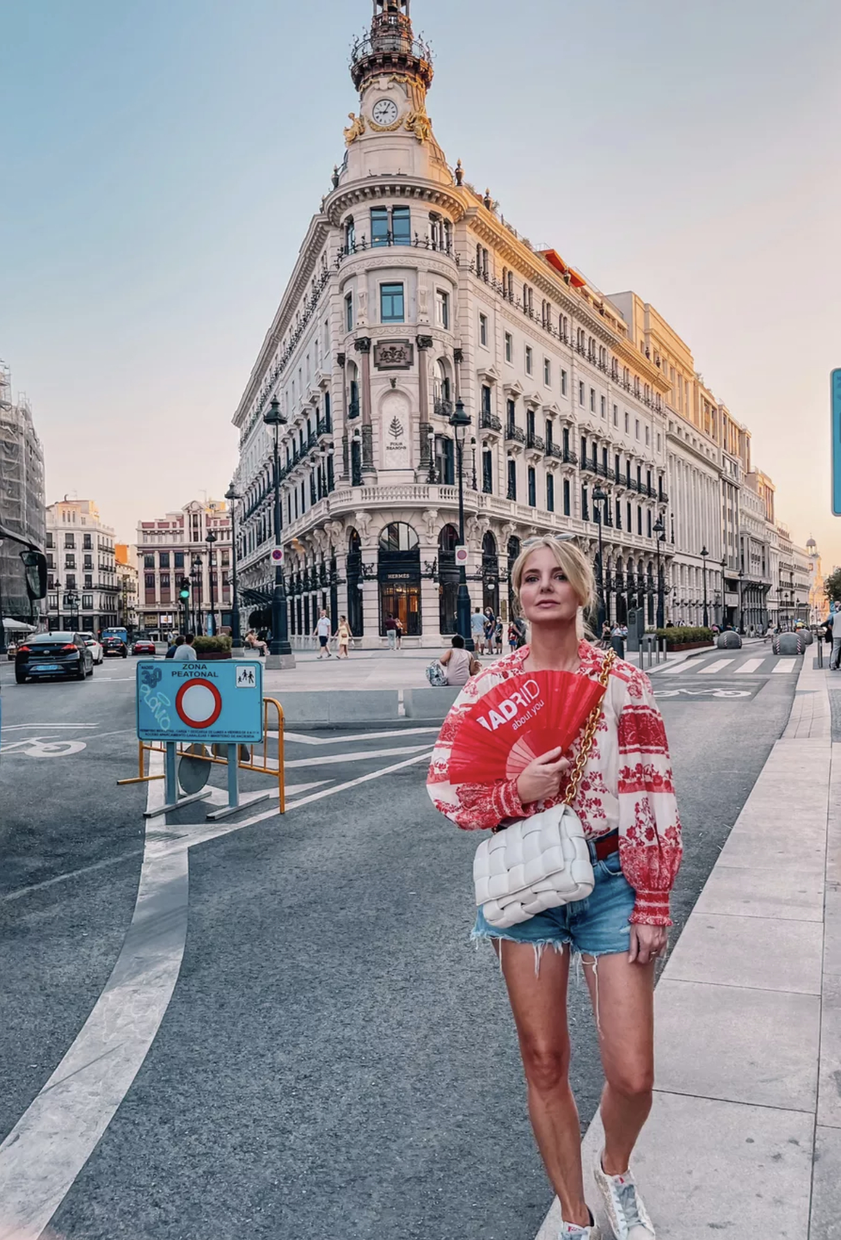 move to spain, move to madrid, why move to spain, where to move in spain, moving to spain, how to move to spain, where to live in spain, Erin Busbee, white and red embroidered alice + olivia blouse with denim shorts by moussy
