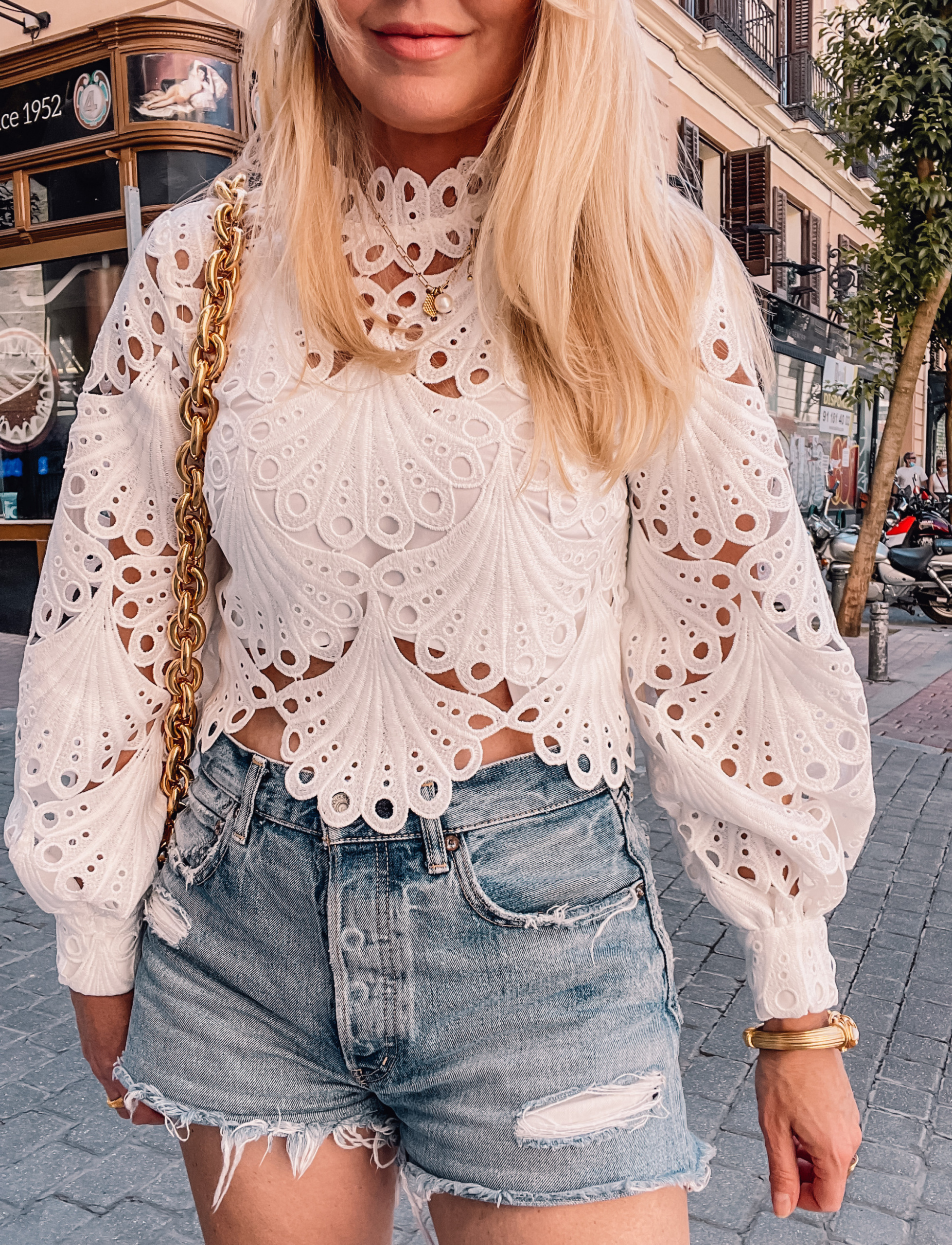 what to wear in spain, how to dress in spain, madrid, how to dress in madrid, what to wear in madrid, how to pack for a trip to spain, trip to spain, packing for spain, erin busbee, white maje lace top, mmoussy vintage jeans, bottega veneta chain cassette bag