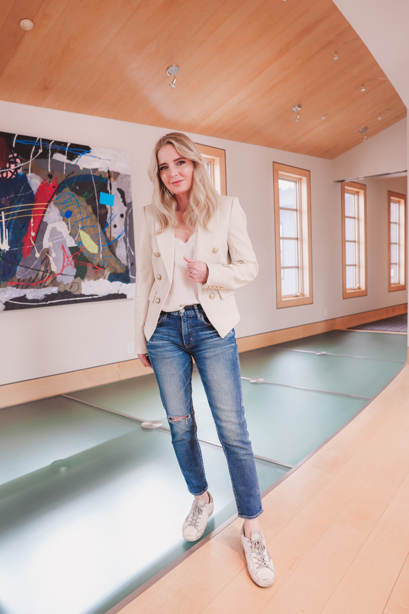 creating the perfect outfit featuring a leather blazer by Veronica Beard, moussy vintage tapered jeans and a camisole on fashion over 40 blogger Erin Busbee