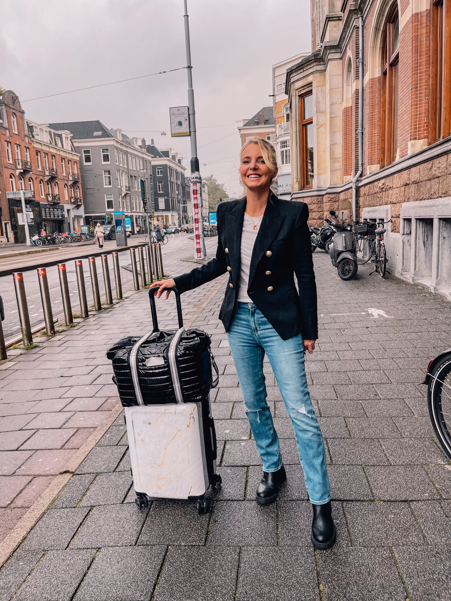 where to travel from spain, travel from spain, travel from madrid, Amsterdam, Netherlands, erin bsubee, where to travel, weekend trips from spain, weekend trips from madrid, where to travel in europe, balmain blazer, paige ripped stright jeans, steve madden booties, free people long sleeve ruched tee, think royln tote, calpak suitcase