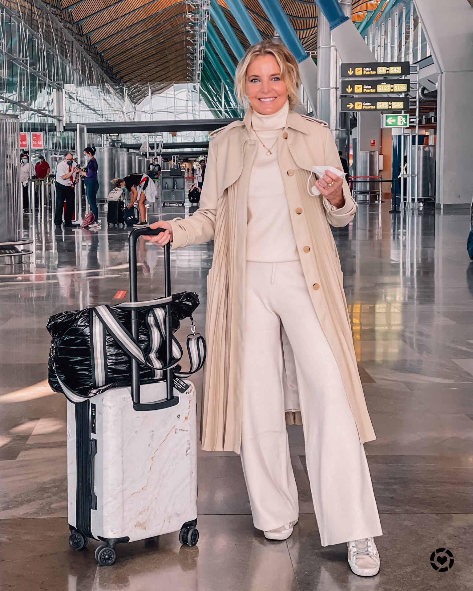 where to travel from spain, travel from spain, travel from madrid, erin bsubee, where to travel, weekend trips from spain, weekend trips from madrid, london, england, ivory mango set, loungewear set, pleated sandro trench, calpak suitcase, think rolyn tote